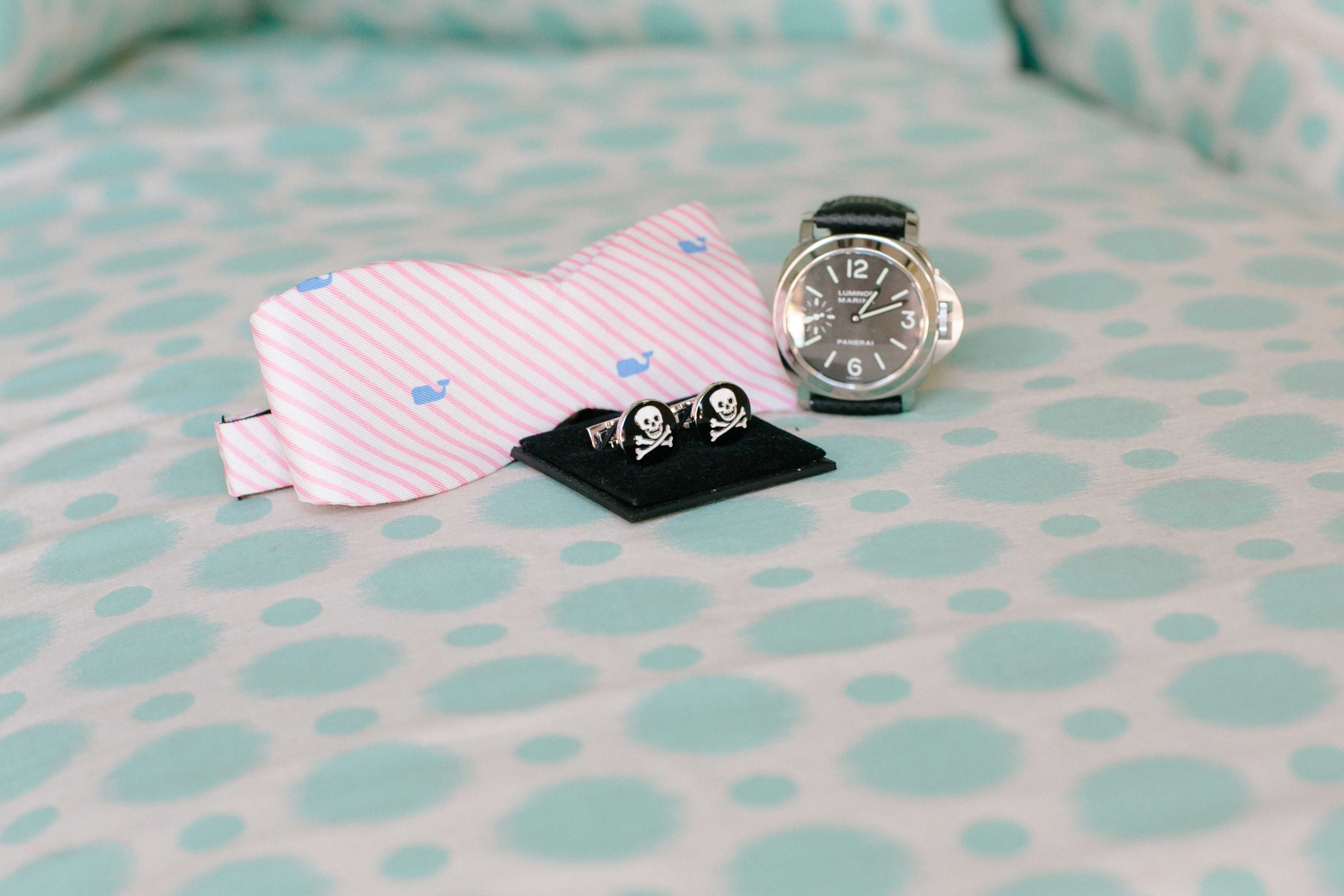 Pink bow tie and cuff links wedding detail shot photography
