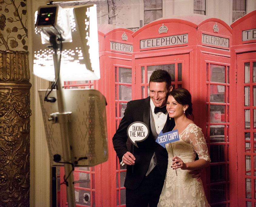 Bride and groom in front of phone booth photo booth