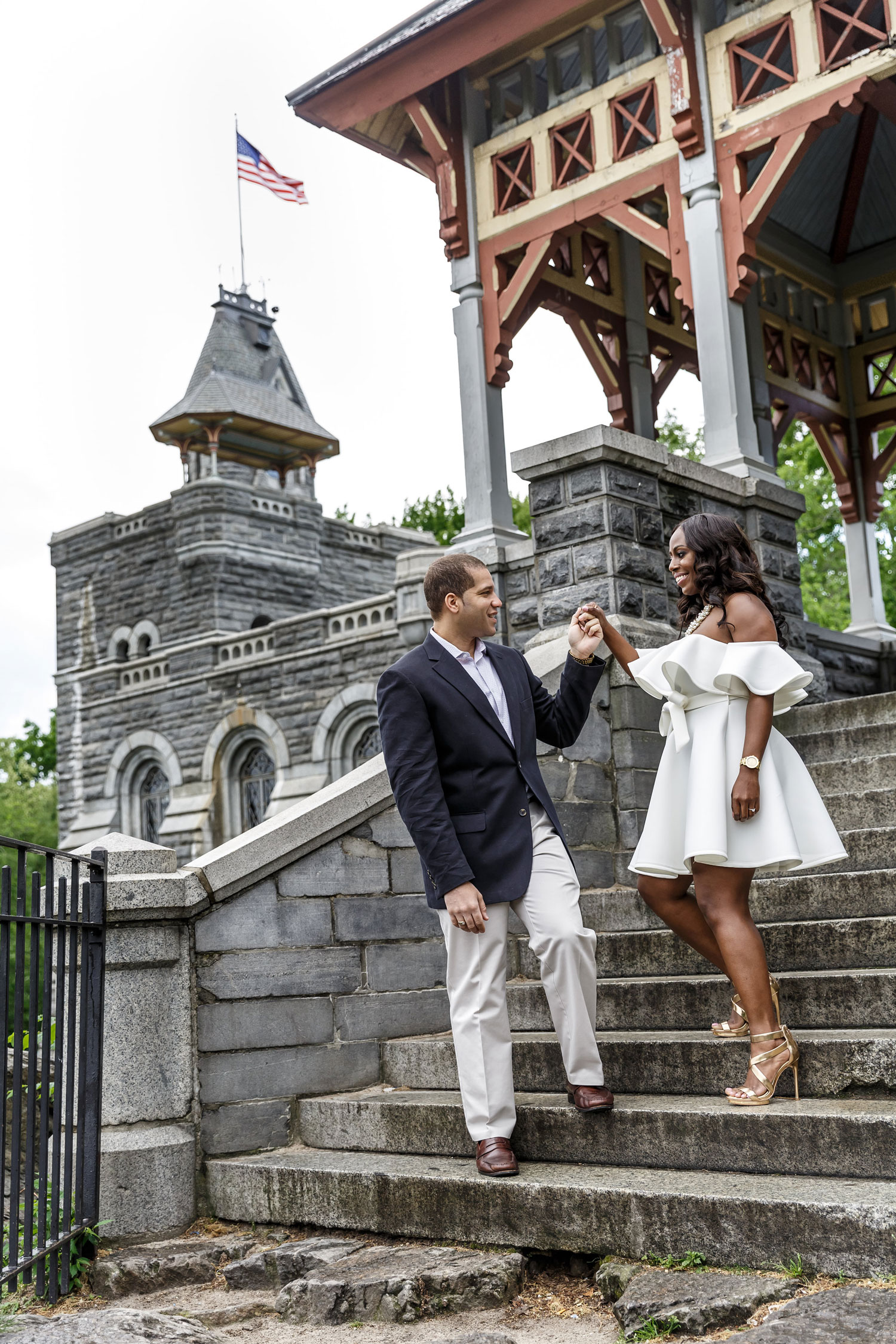 New York City central park engagement session photo by Amy Anaiz walking down stairs