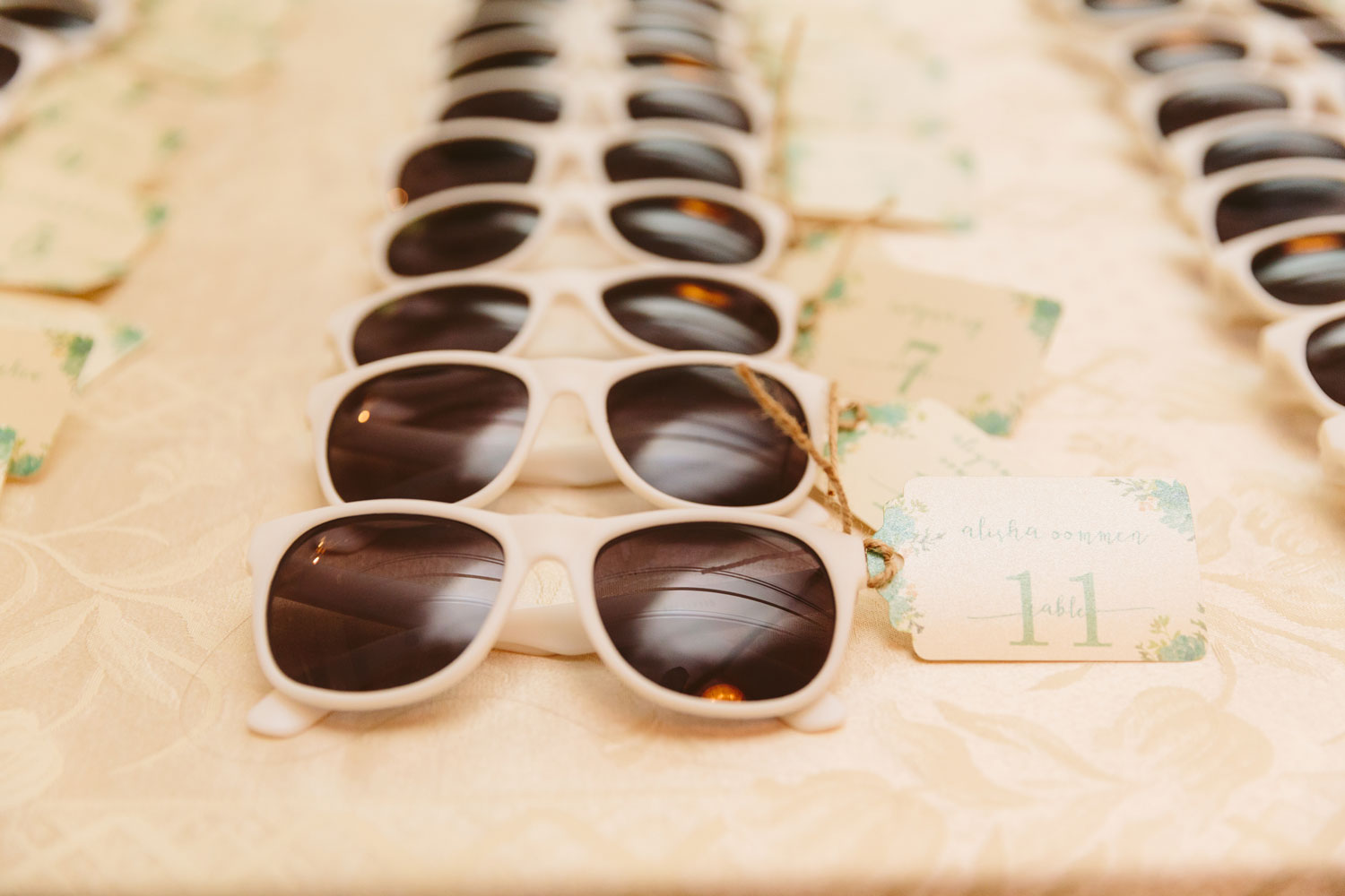 Escort cards attached to sunglasses wedding reception ideas