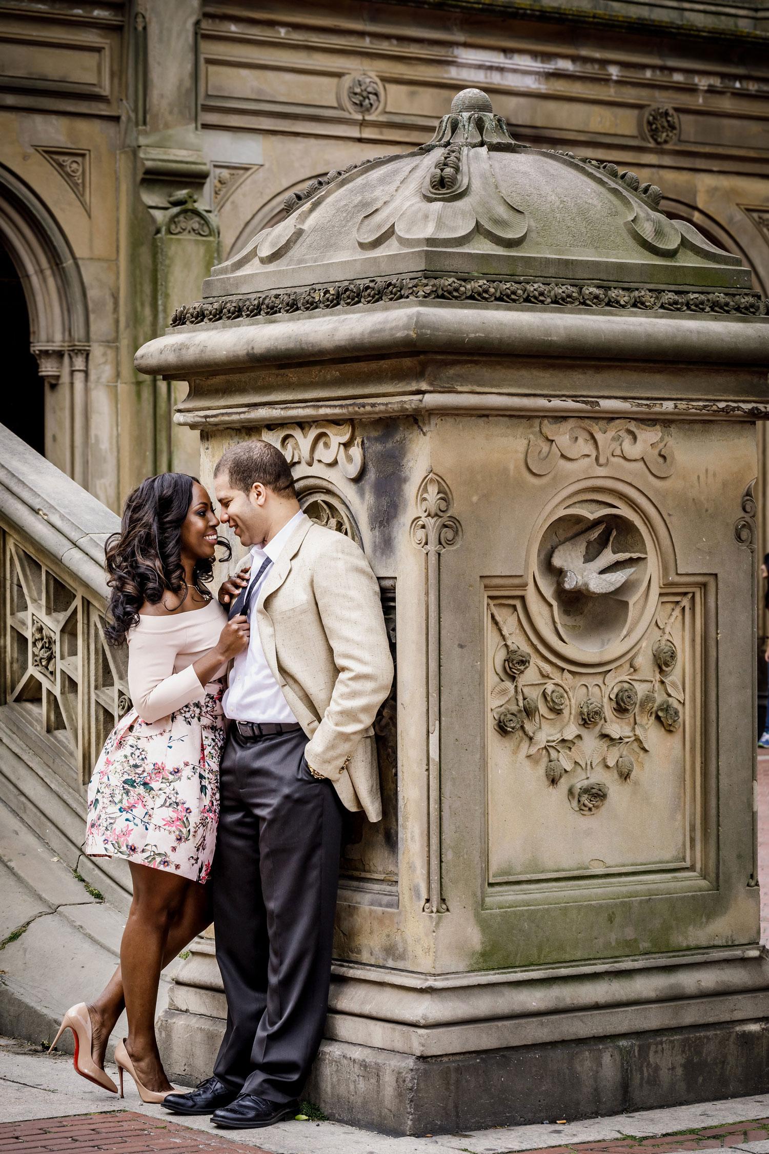 New York City central park engagement session photo by Amy Anaiz Bethesda Fountain kissing at base of stairs