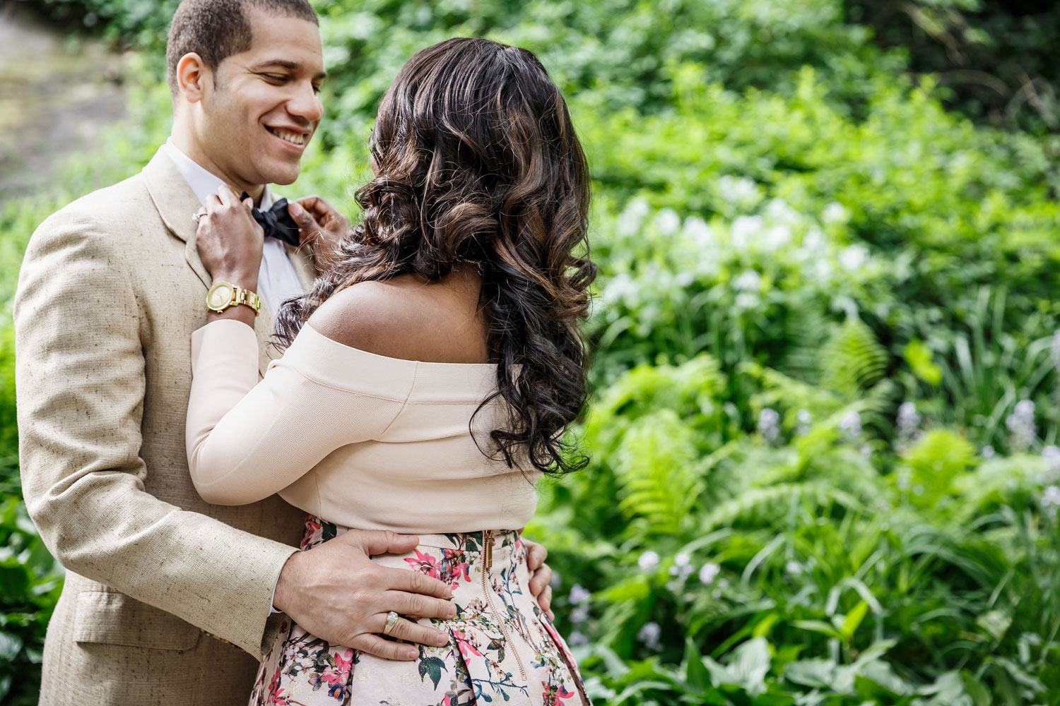 New York City central park engagement session photo by Amy Anaiz bride to be tightening bow tie
