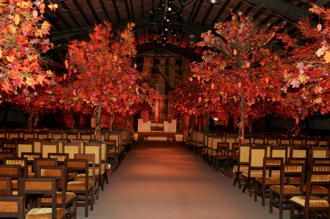 fall foliage trees line wedding ceremony aisle