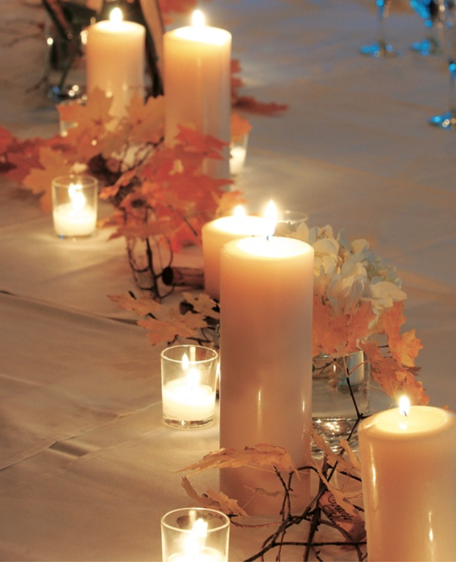 garland of fall leaves with ivory pillar candles