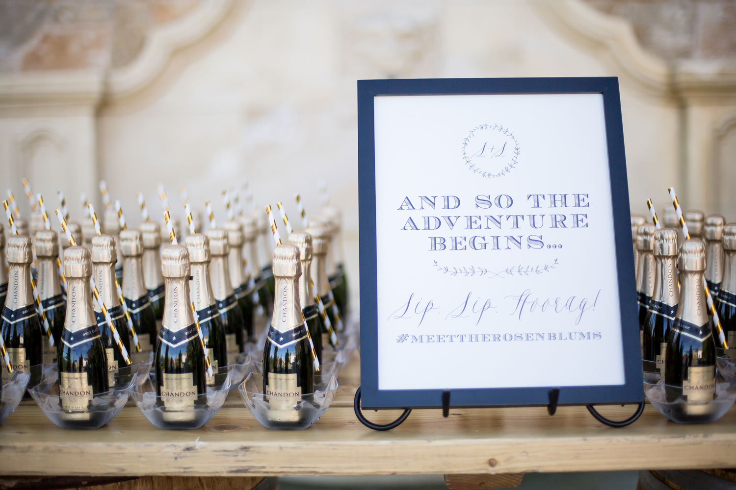Champagne glasses escort cards with wedding hashtag