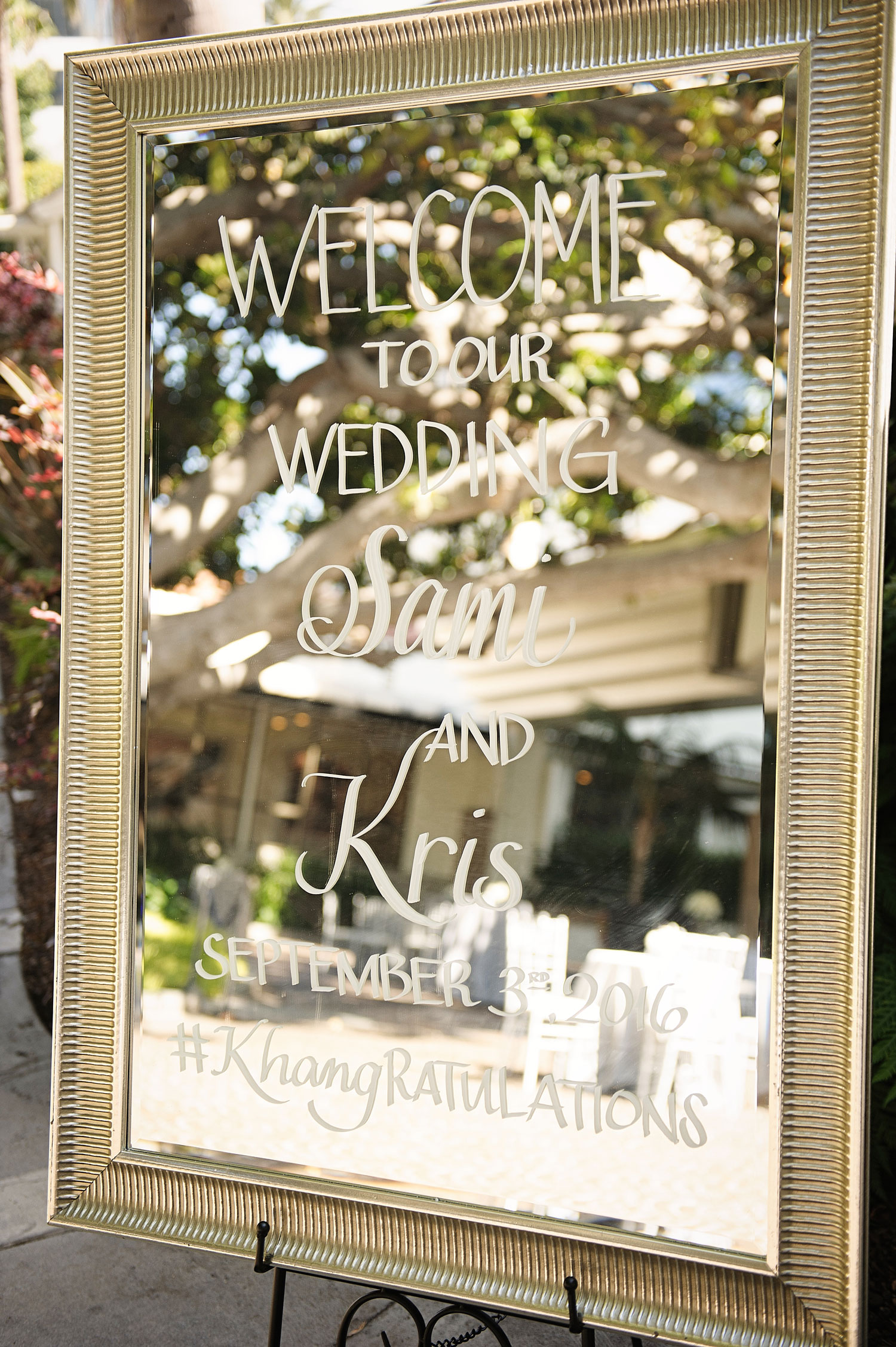 Mirror with wedding hashtag