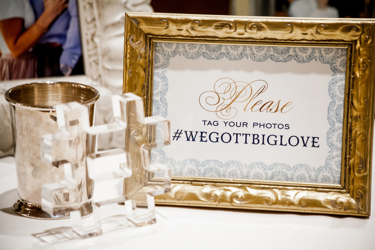 Framed wedding hashtag sign at reception