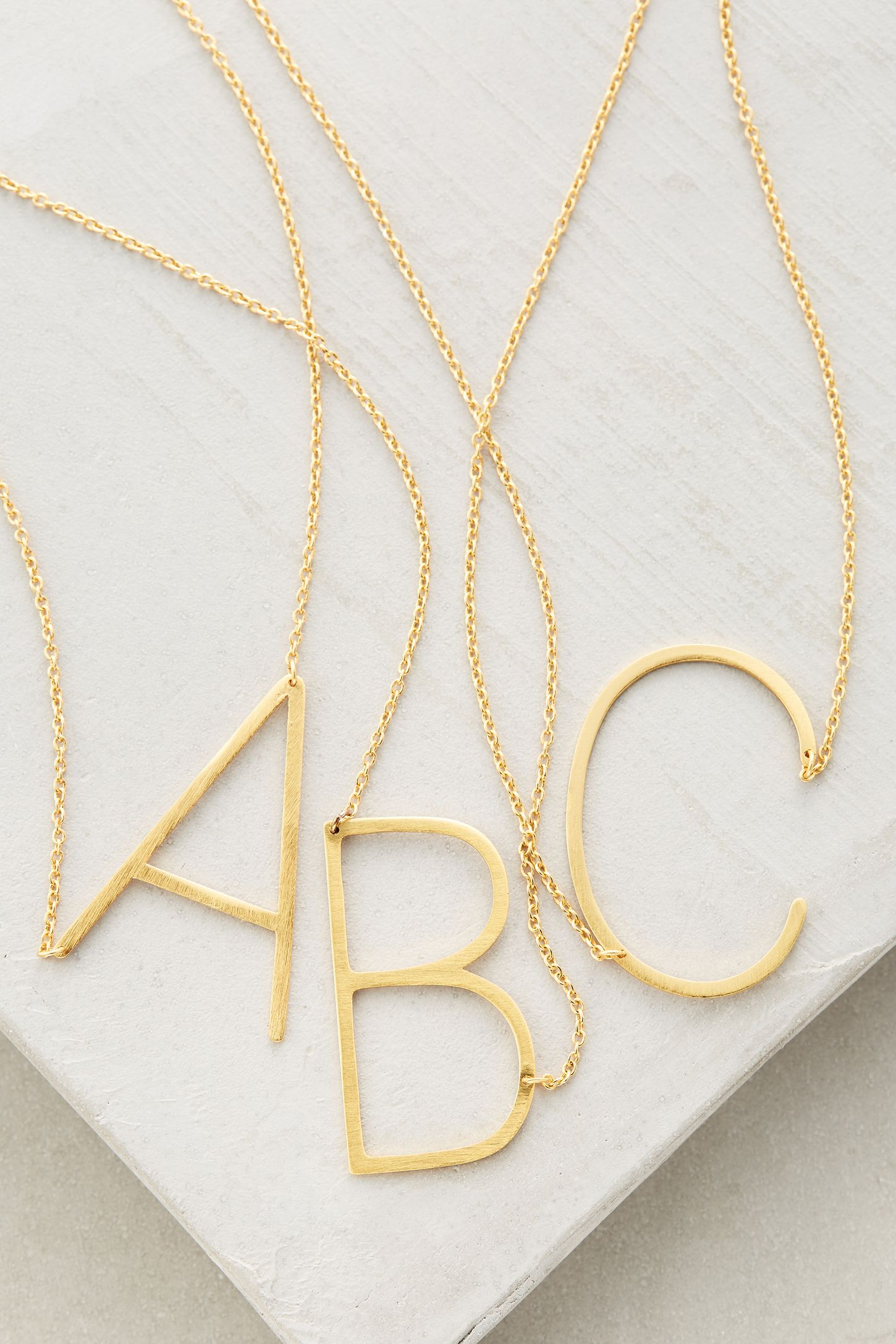 Gold initial monogram pendant necklaces from Anthropologie holiday gift guide
