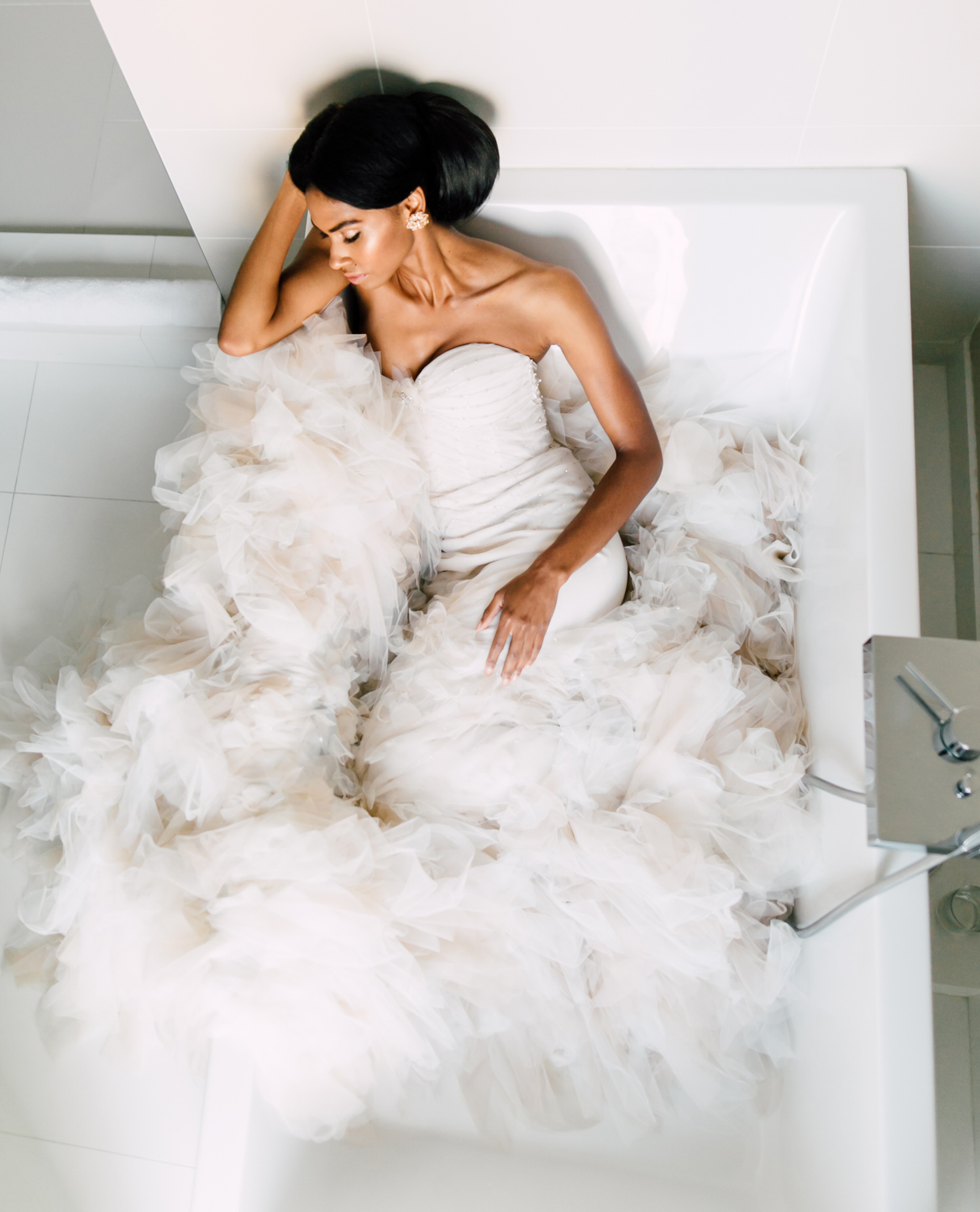 bride in inbal dror mermaid wedding dress posing in bathtub