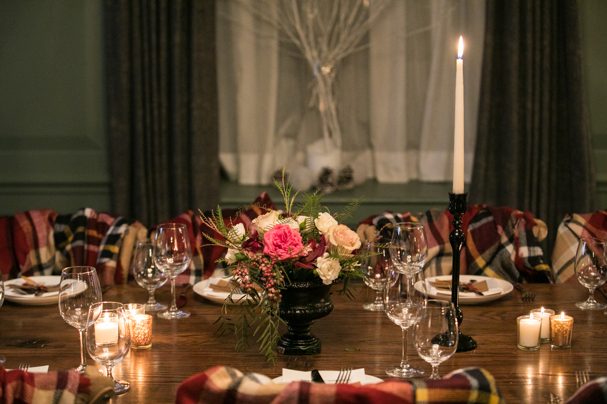 holiday party decor florals and tapered candle, how to throw a holiday party