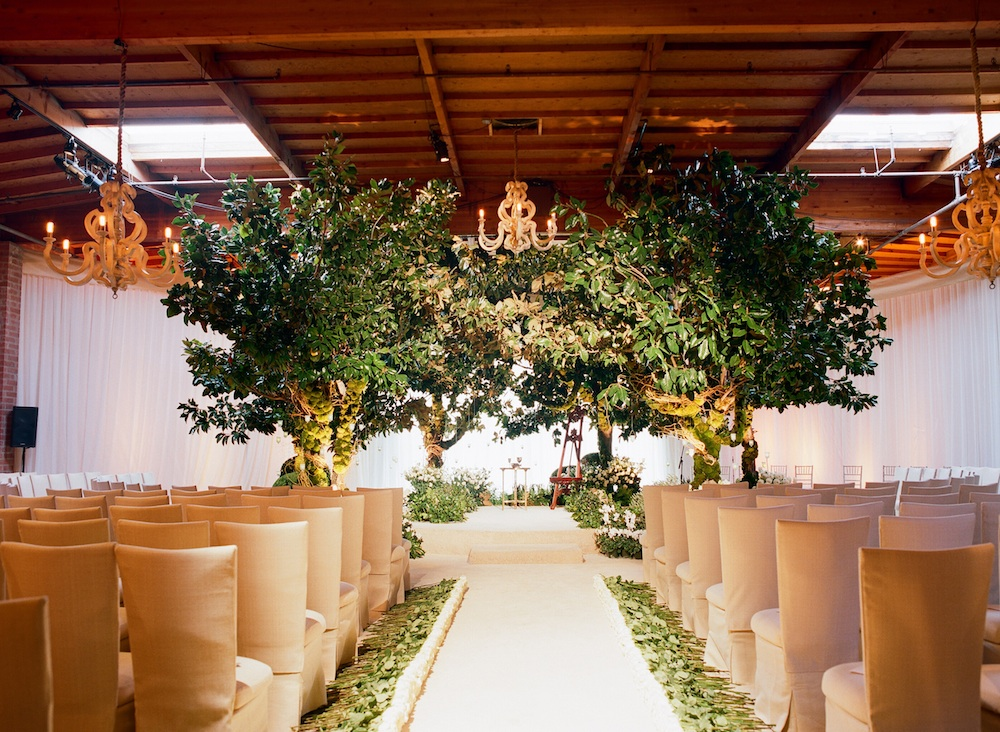 wedding ceremony chuppah made from trees indoors