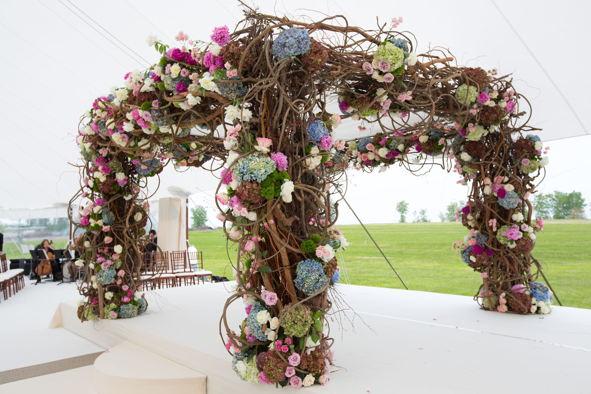 bramble of branches for chuppah with purple and blue hydrangeas