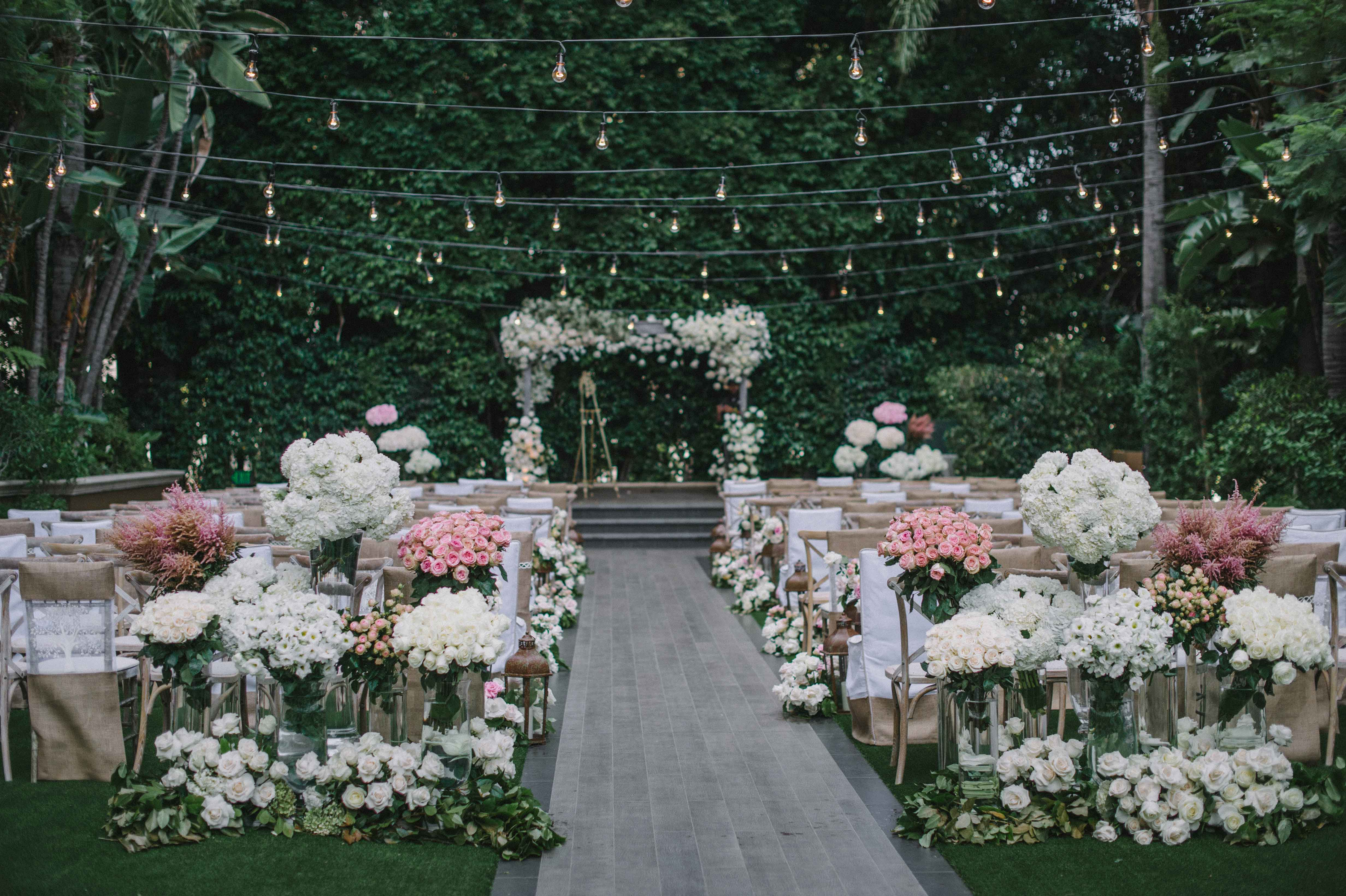 chuppah of white flowers on stage