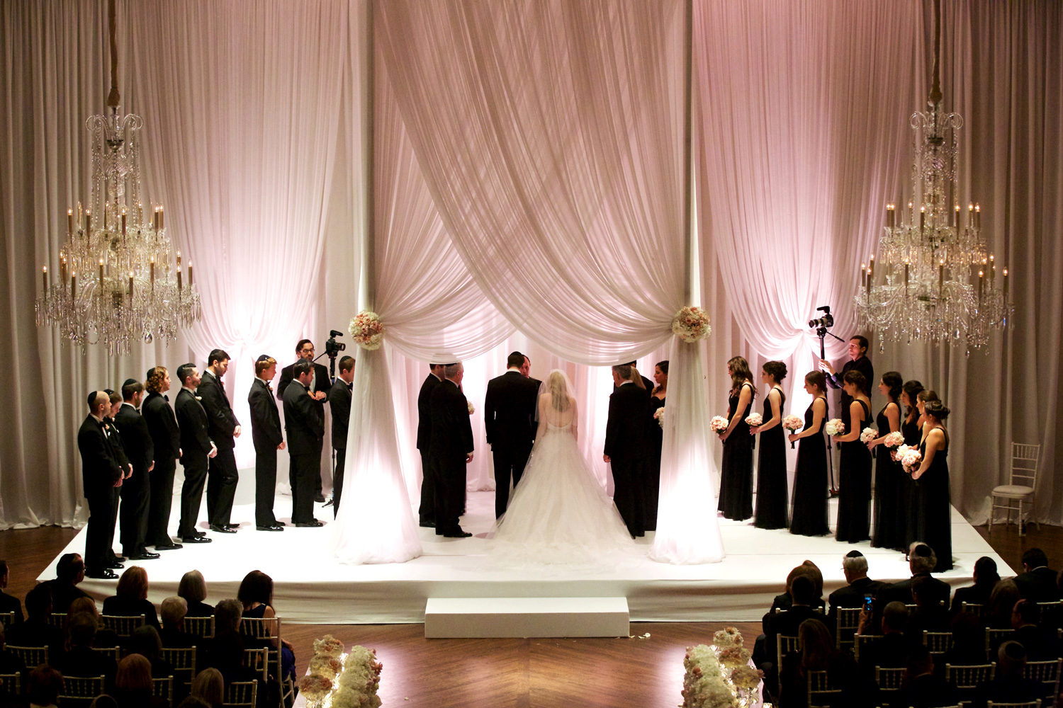 tall chuppah with made rom white drapery for indoor jewish wedding