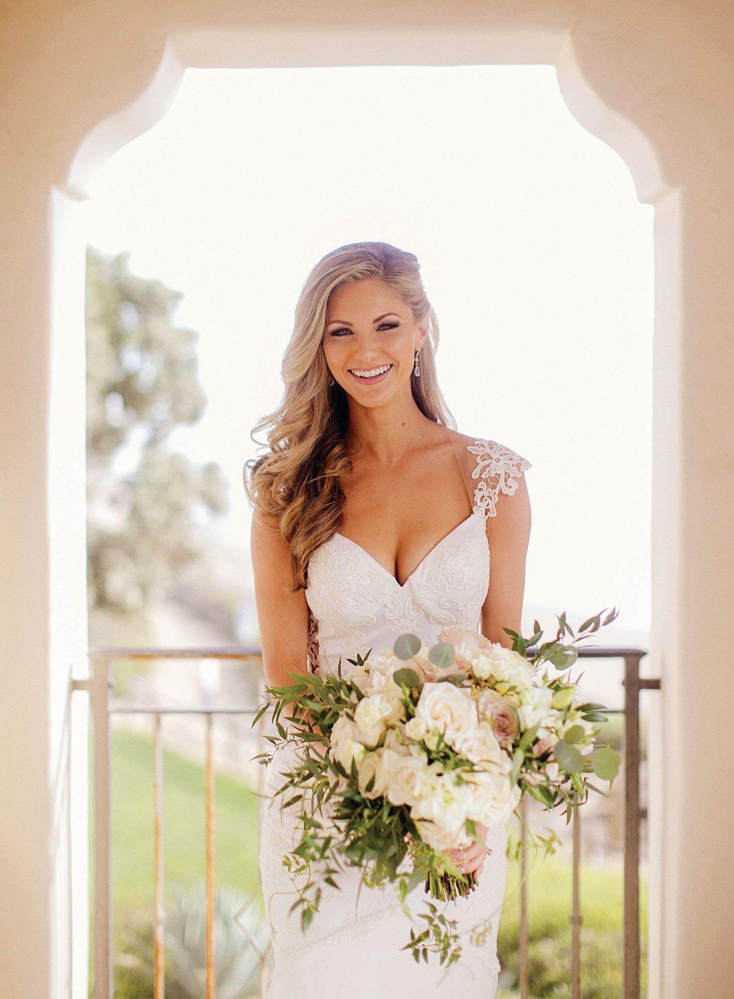 Bride with bouquet and pretty dress Inside Weddings winter 2018 issue preview real weddings wedding ideas