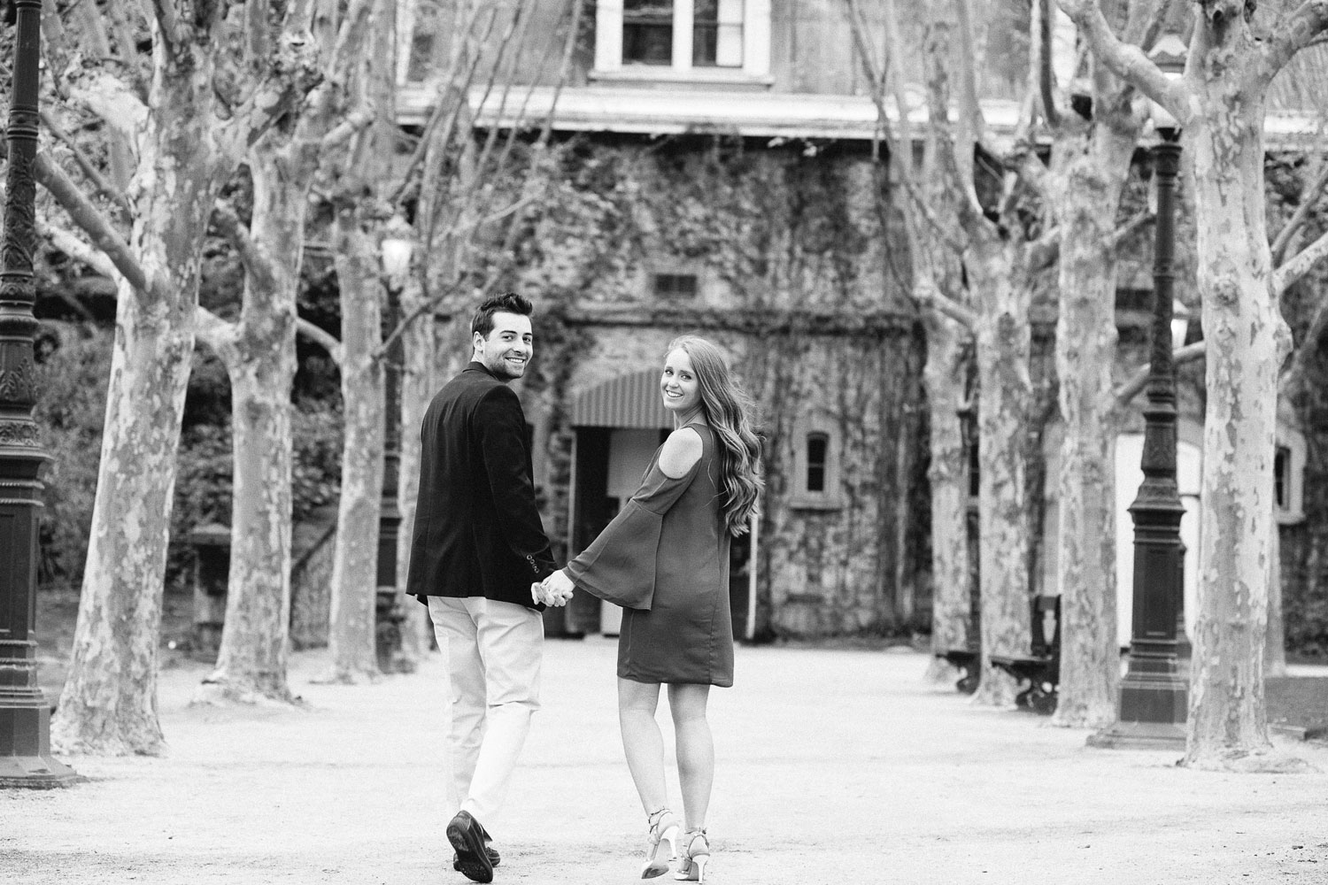 Black and white photo of bride and groom at winery after proposal