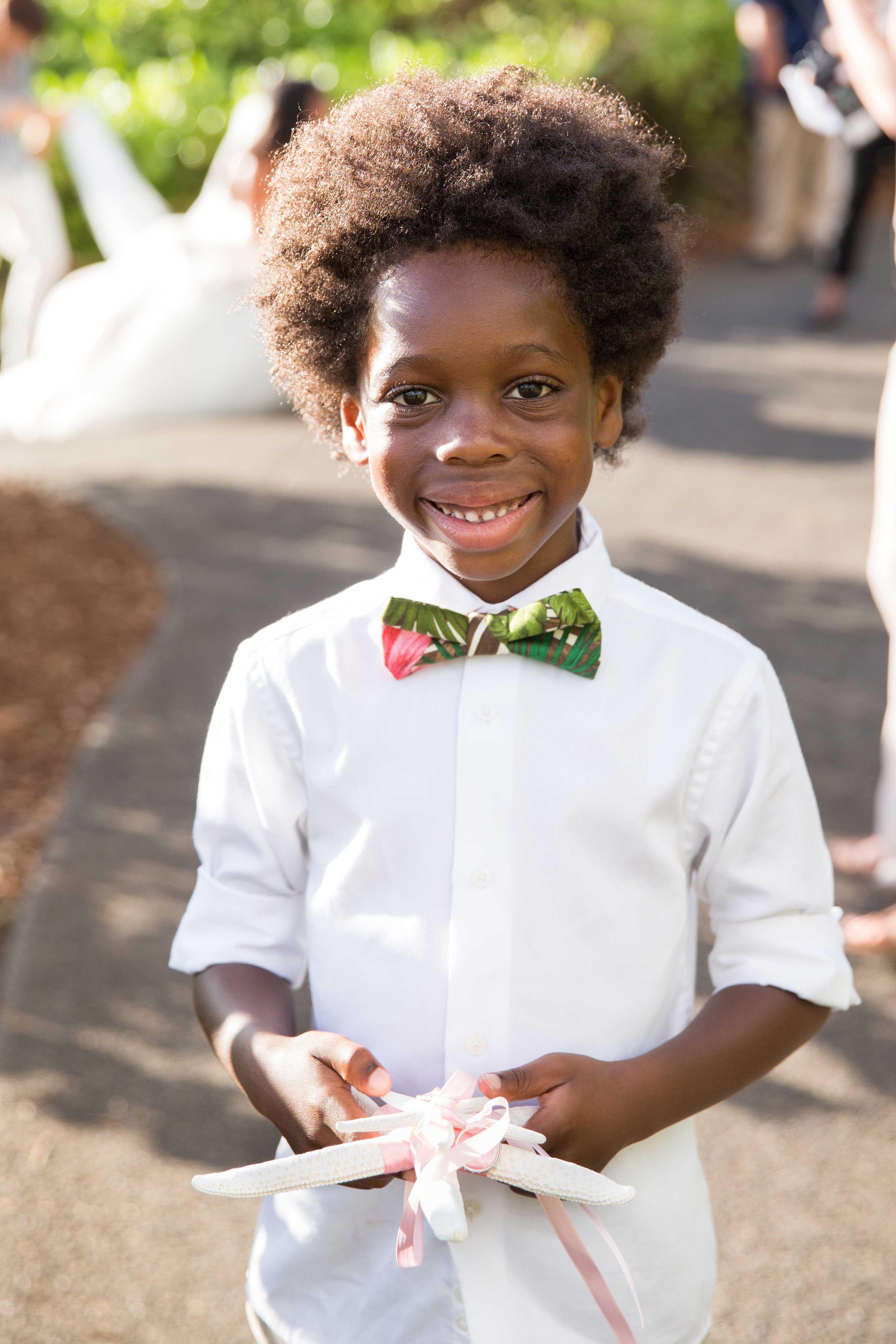 Chudney Ross destination wedding in Hawaii ring bearer holding starfish Diana Ross grandson