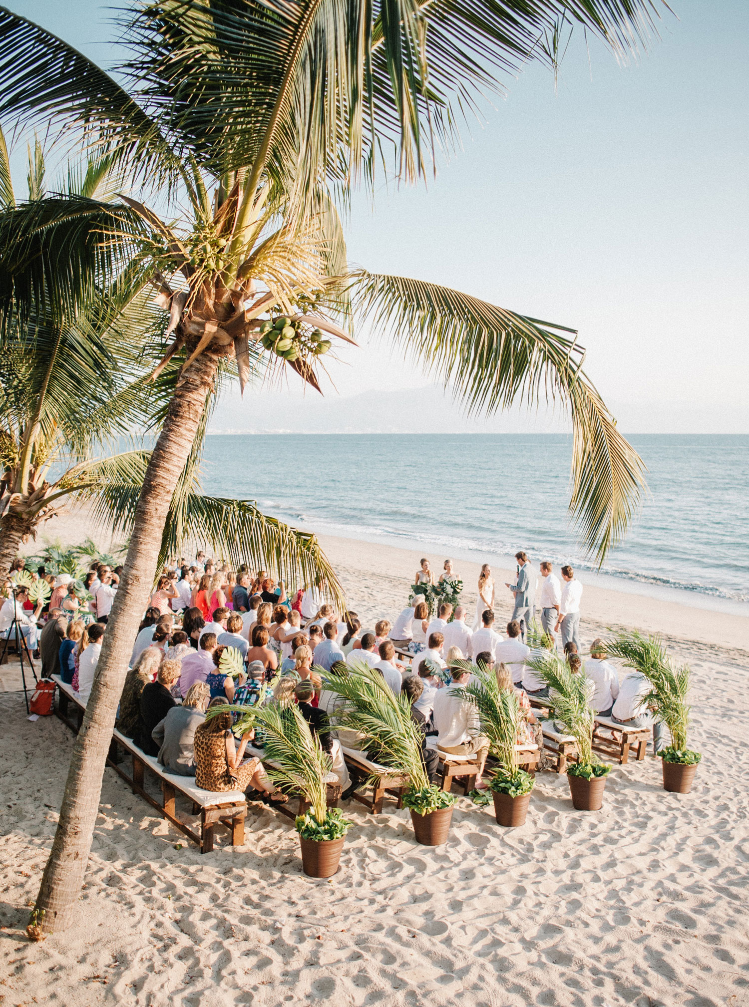 Destination wedding ceremony on beach sand in Mexico with ocean view