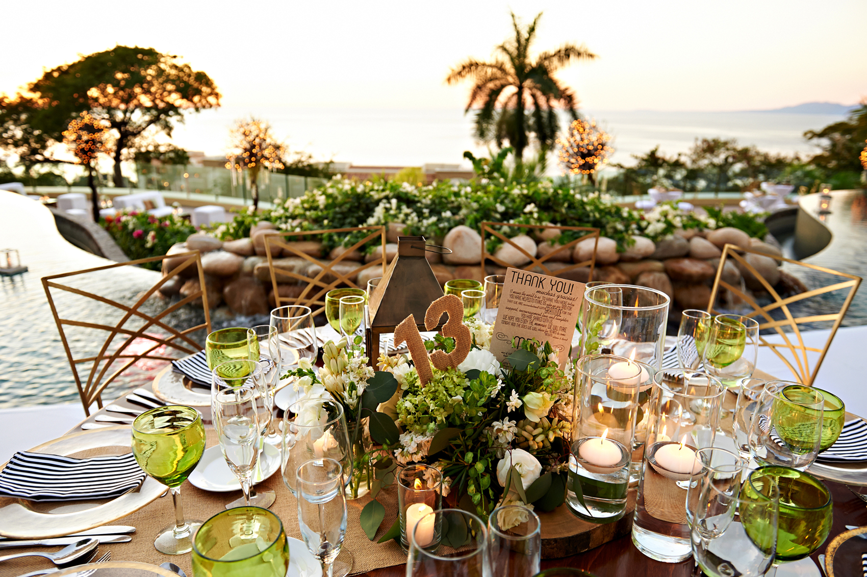 Destination wedding reception tablescape overlooking pool and ocean Mexico