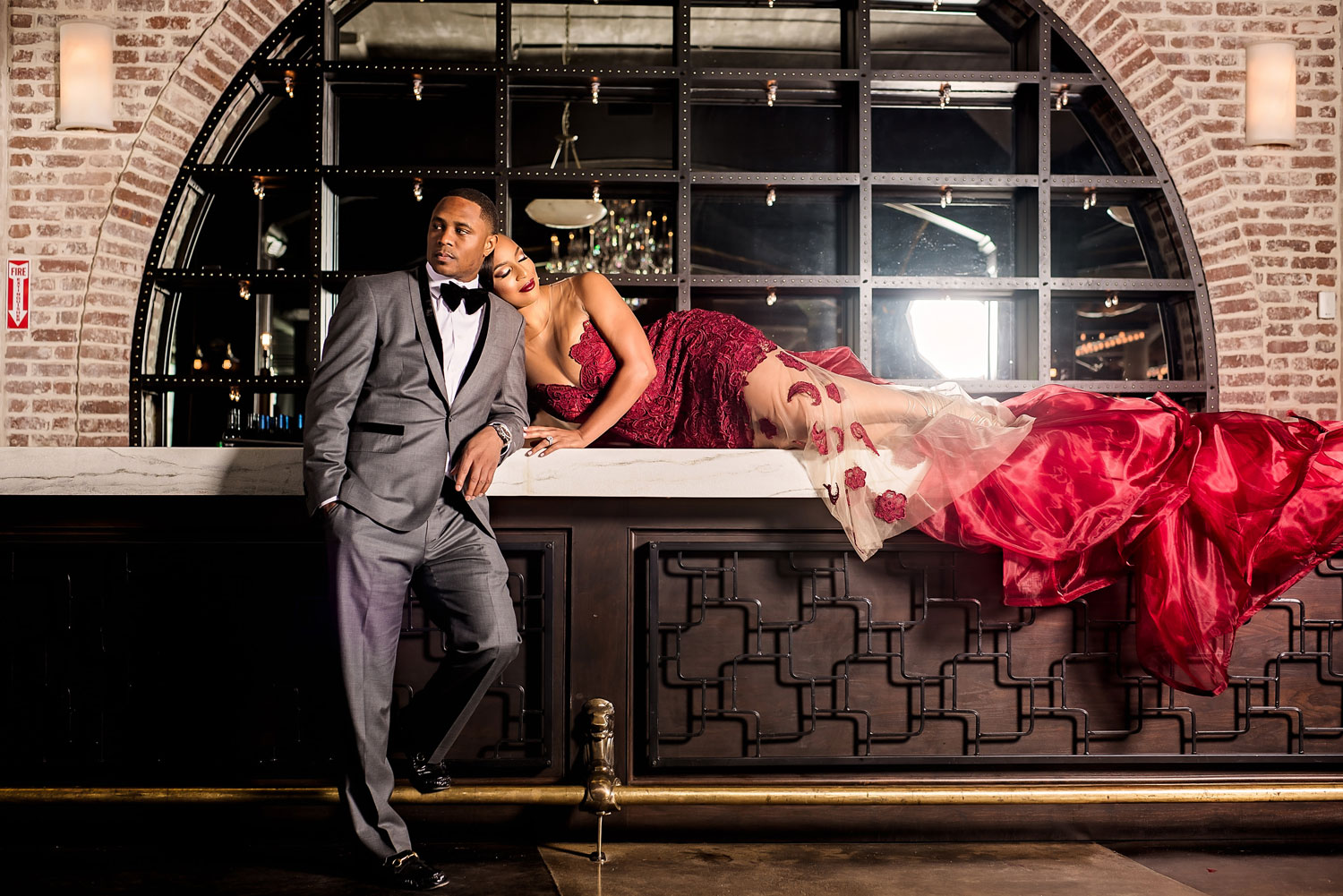 Kacey Angulo and Tony Sipp Houston Astros baseball player wedding engagement photo shoot session on bar