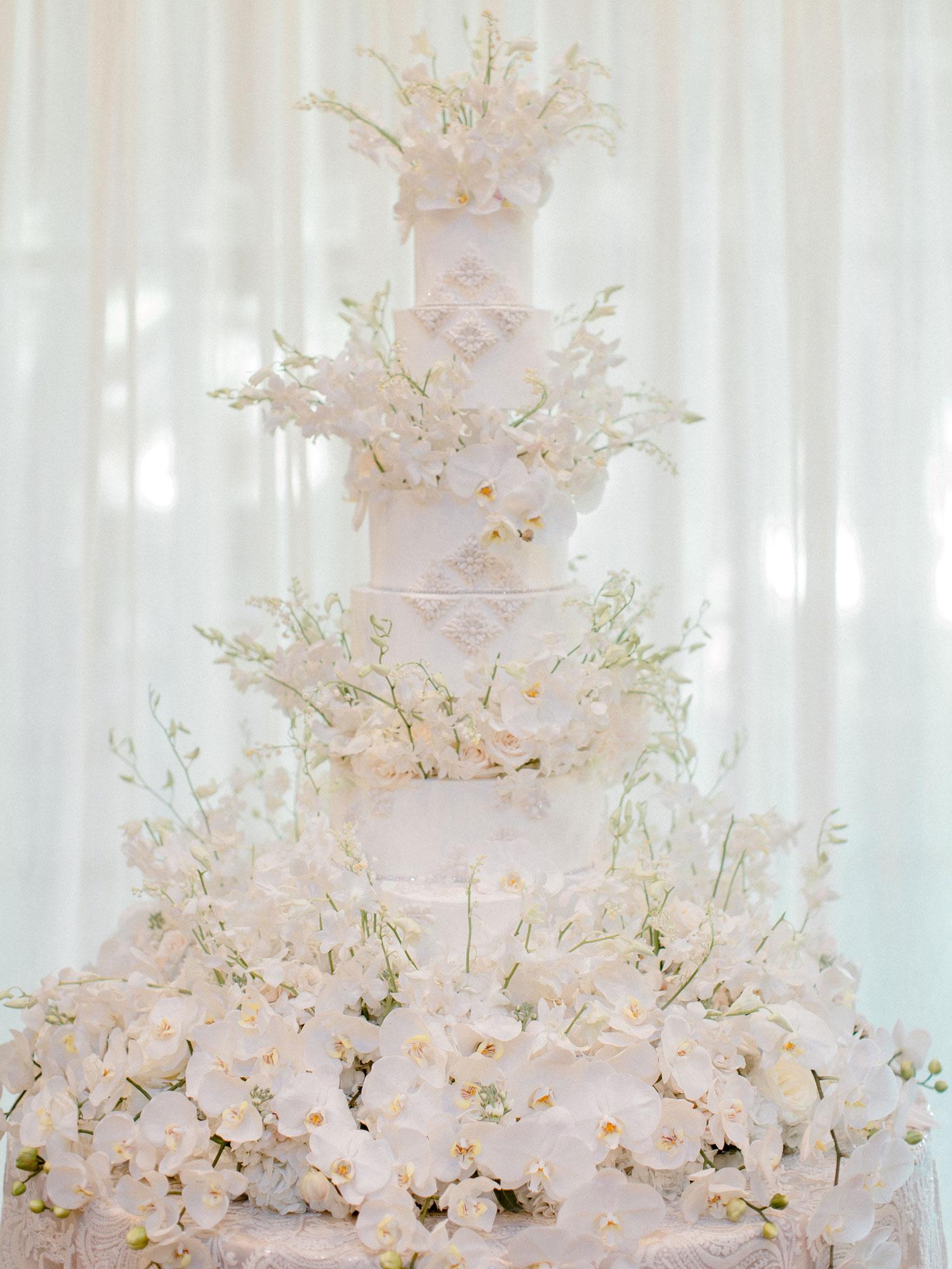 Opulent white wedding cake ideas with hundreds of sugar flowers