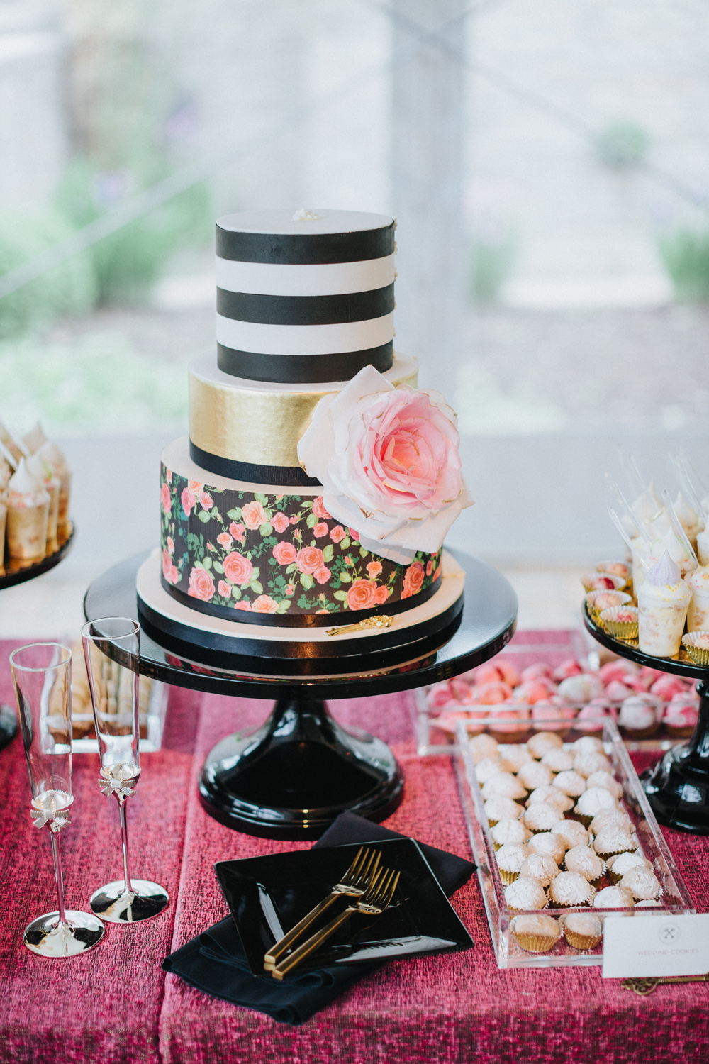 Preppy wedding cake with different tiers stripes and flower pattern designs