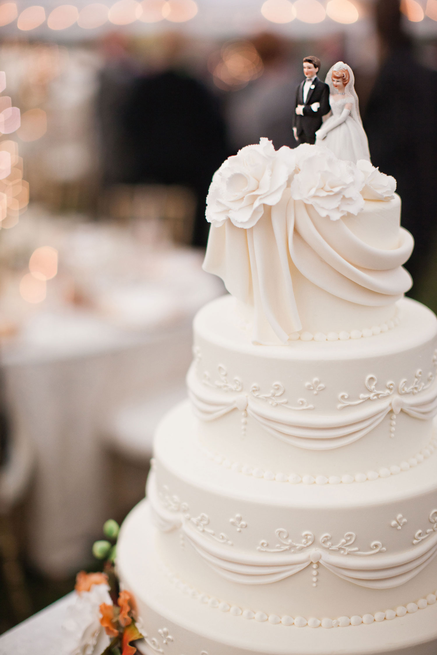 Classic vintage wedding cake with filigree detail and classic cake topper