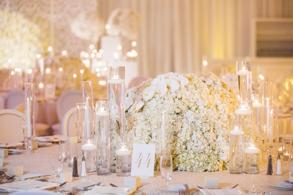 All white reception decorations low centerpiece white flowers