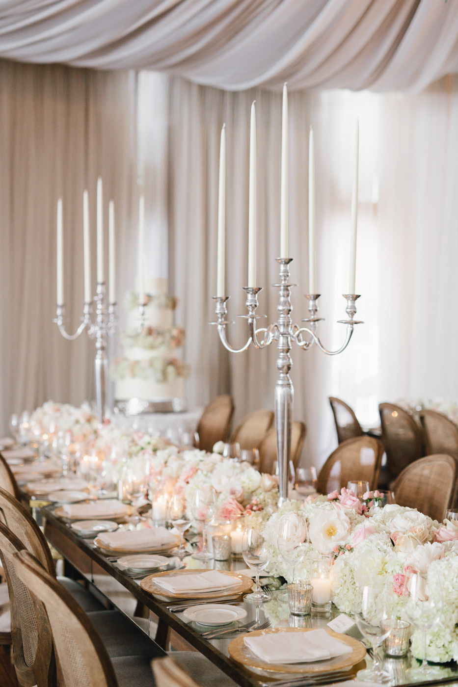 Long king's table wedding reception tall candelabra low flower centerpieces