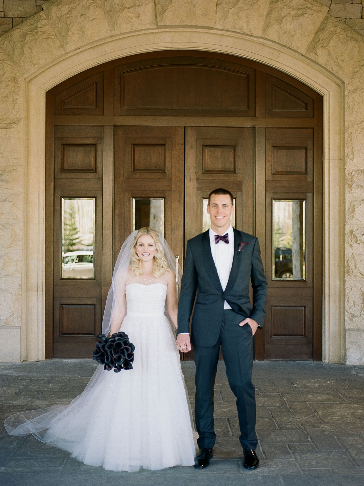 Bride and groom portrait dark black bridal wedding bouquet flowers