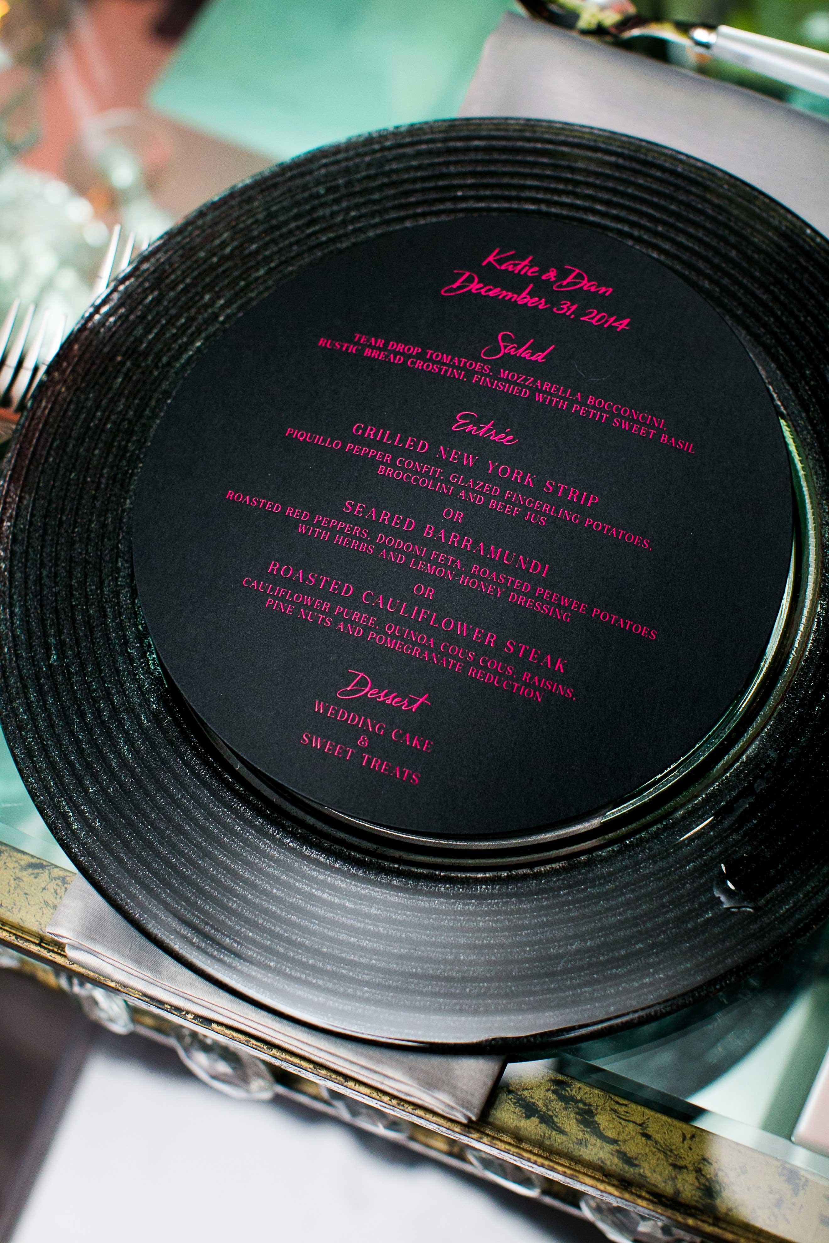 Black charger plate and circle menu card at wedding reception
