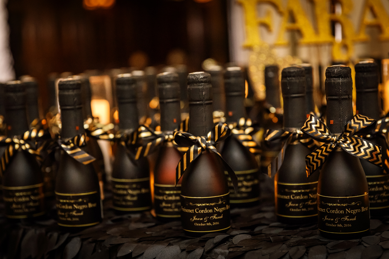 Black champagne bottle wedding favors with bows