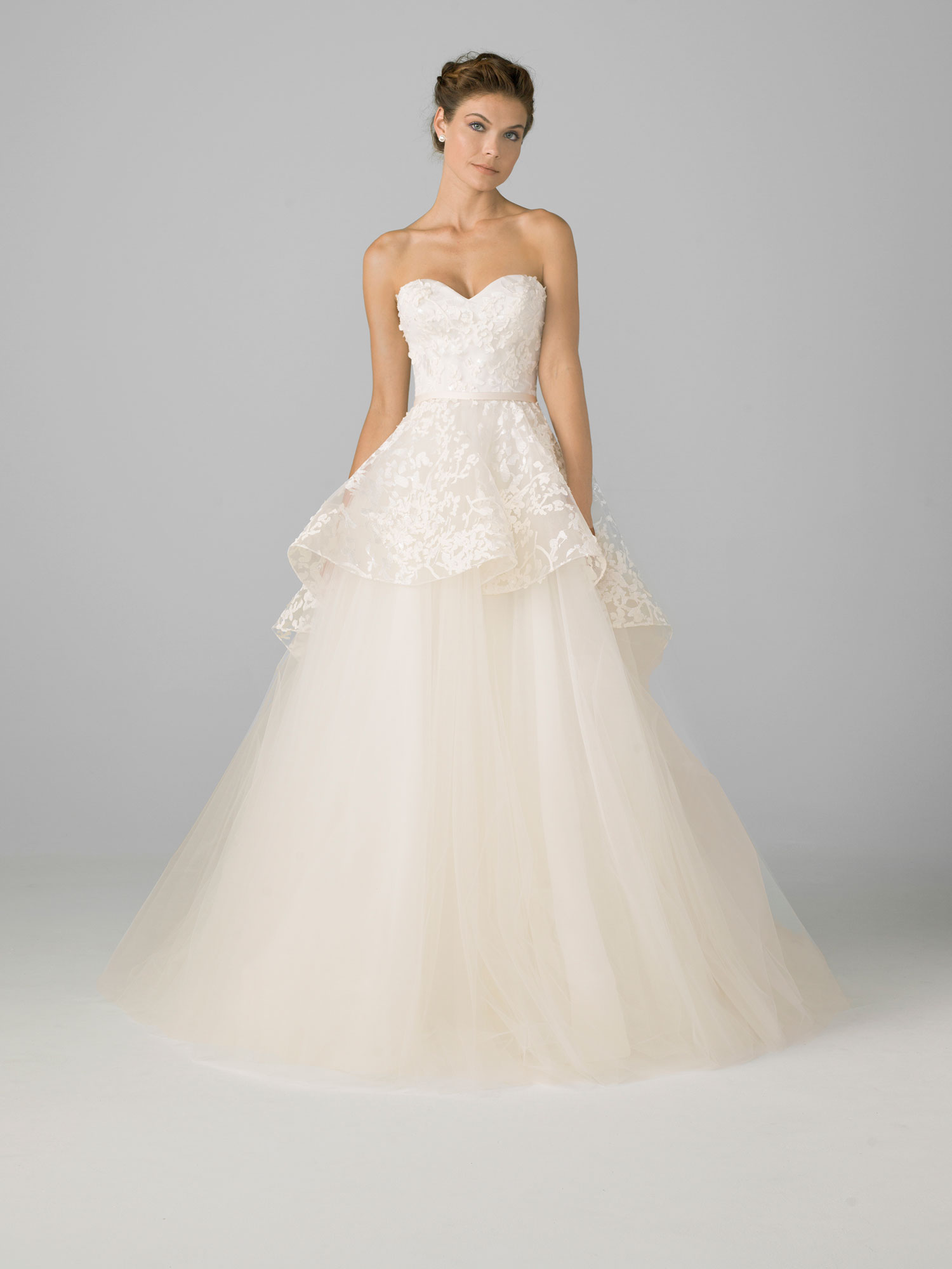 Sweetheart neckline wedding dress bridal gown with peplum detail by Azul by Liancarlo