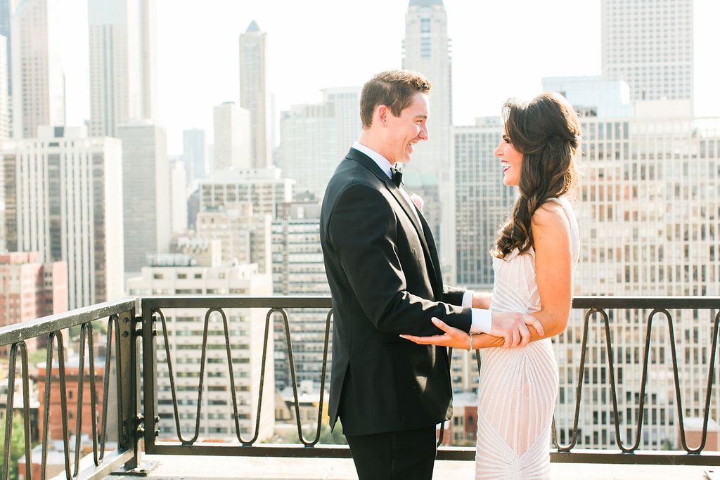 Bride and groom in front of Chicago skyline at venue near where they first met