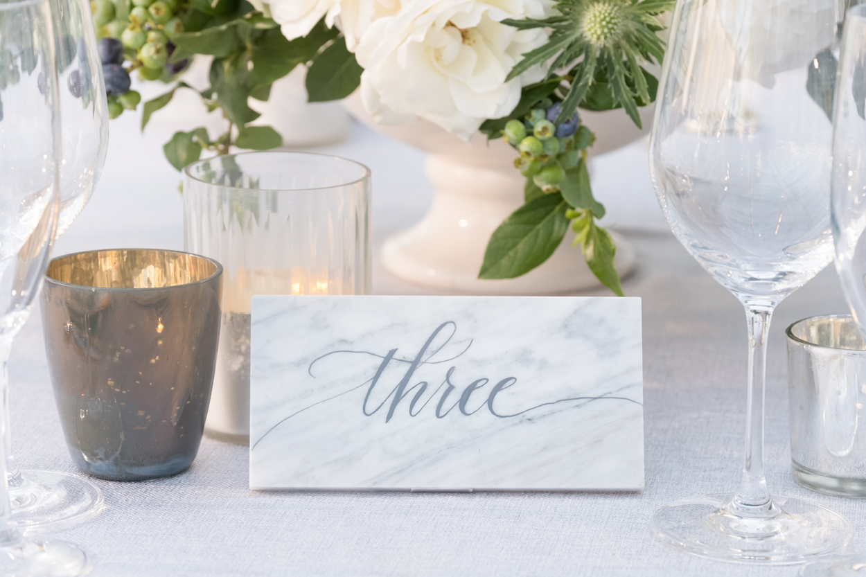 Wedding reception table number written on marble slab