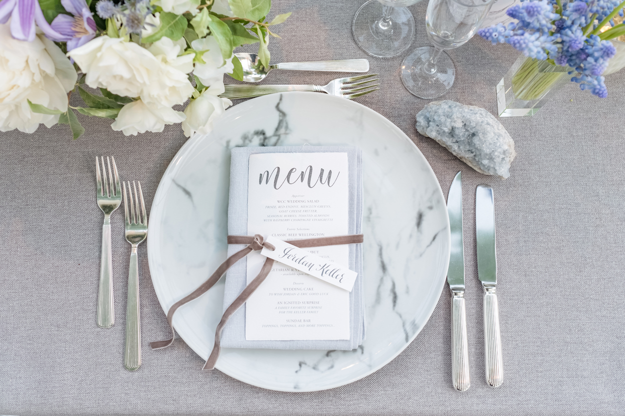 Marble plate at wedding place setting reception table