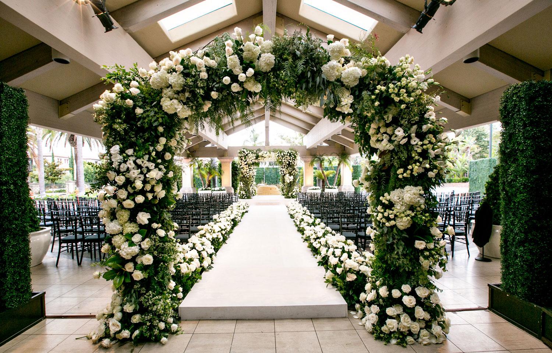 Inside weddings spring 2018 issue greenery white flowers ceremony