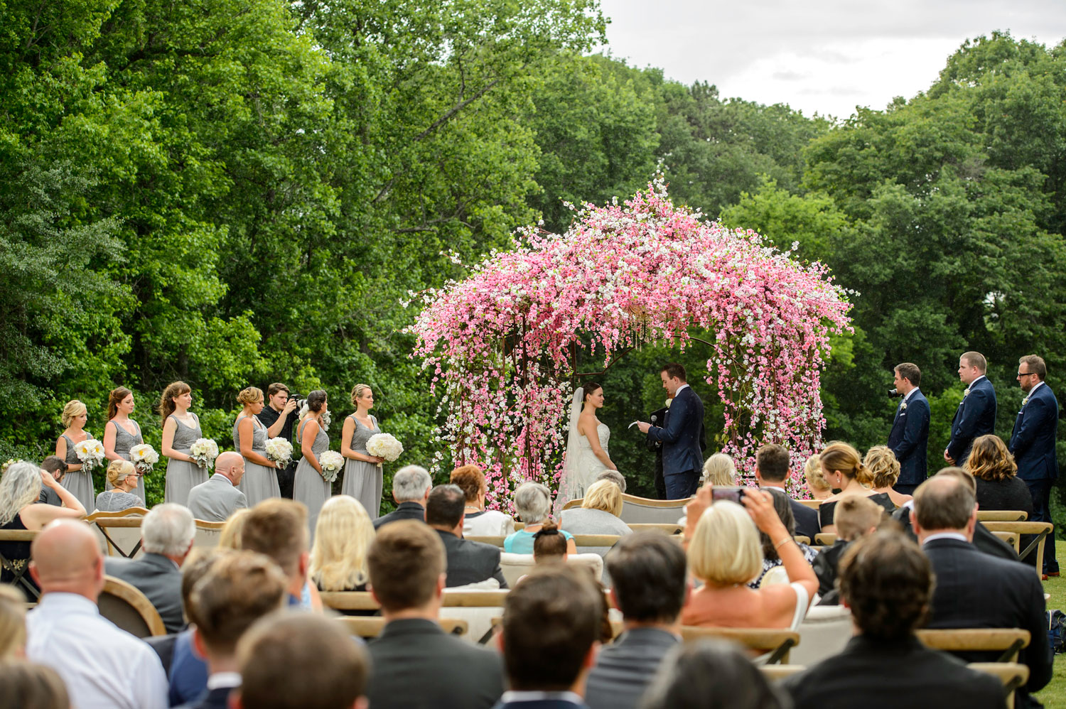 Pink cherry blossom ceremony outdoor wedding by brian green inije photography inside weddings spring 2018 issue