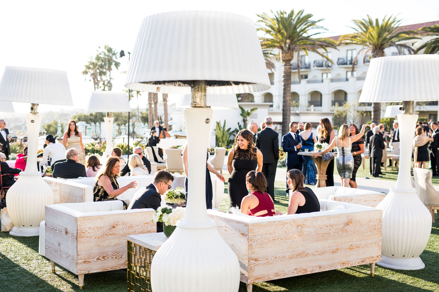 Guests at cocktail hour outside inside weddings spring 2018 issue samuel lippke studios international event company revelry event designers