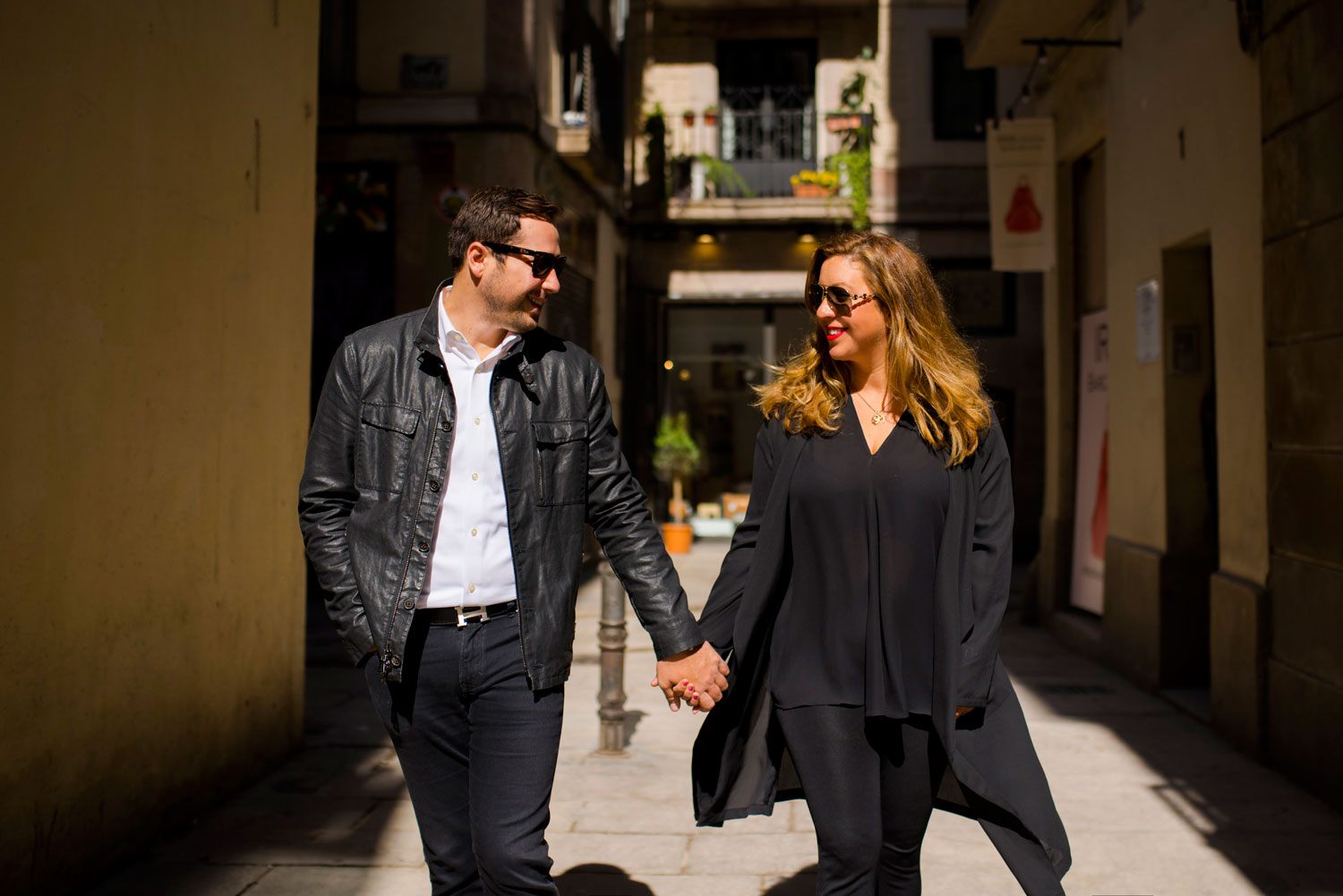 Michelle Durpetti and Collin Pierson engagement photos in Barcelona, Spain holding hands