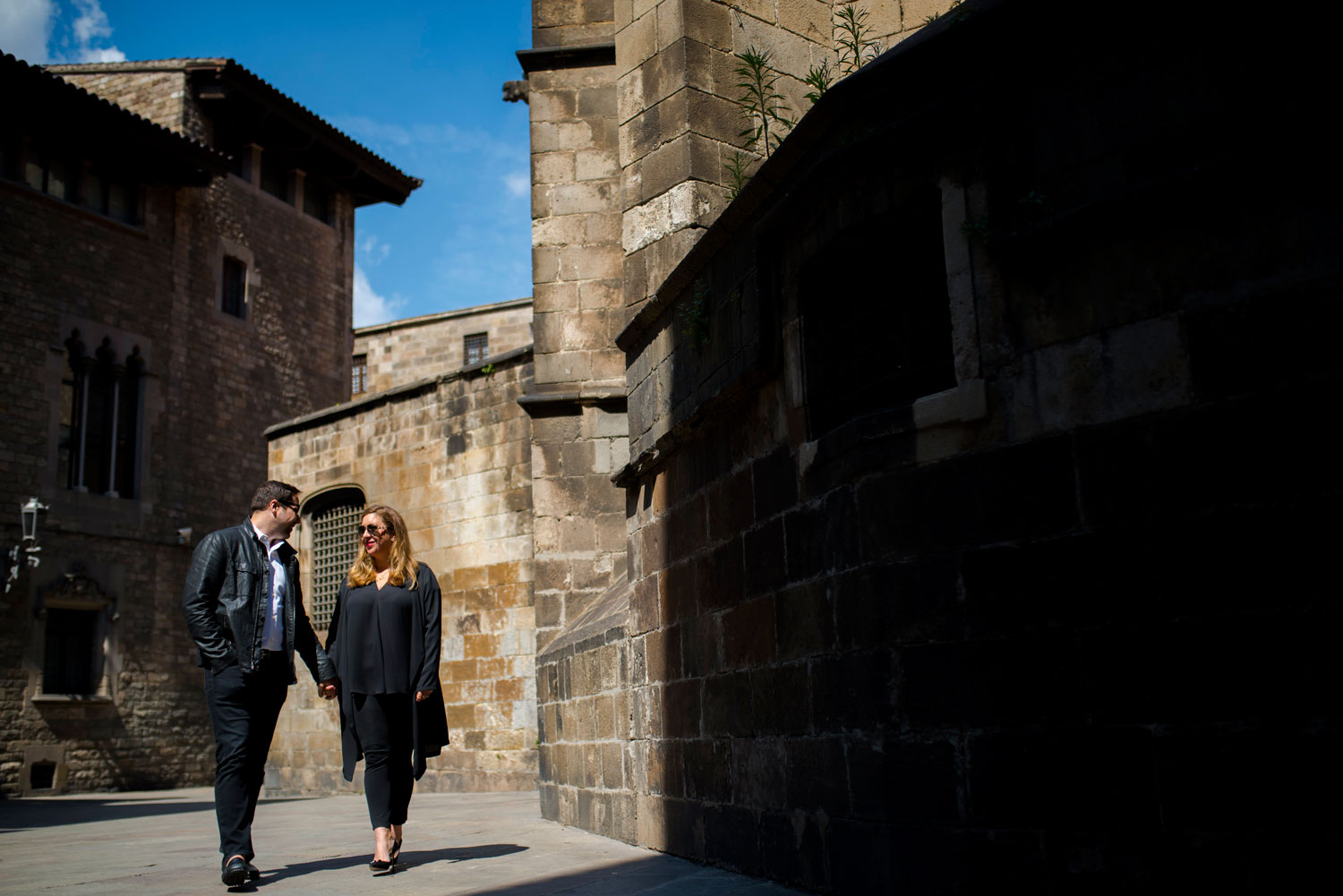 Michelle Durpetti and Collin Pierson engagement photos in Barcelona, Spain holding hands in street