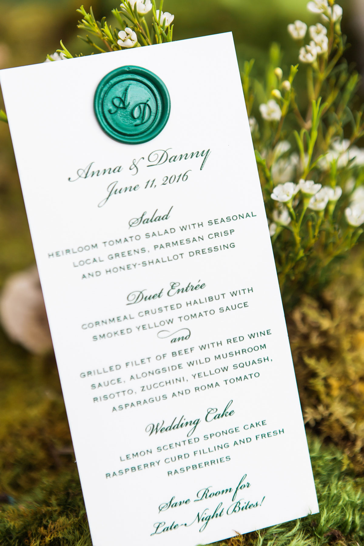 Green wax seal and script on wedding menu card