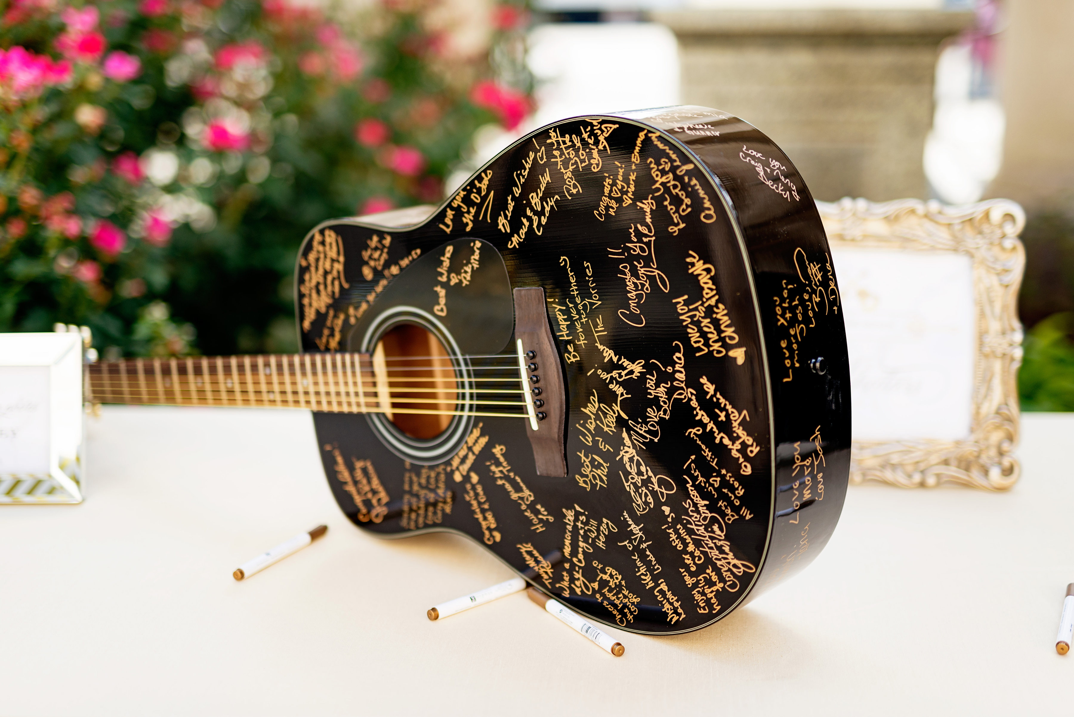 Black guitar with gold writing wedding guest book alternative guestbook ideas