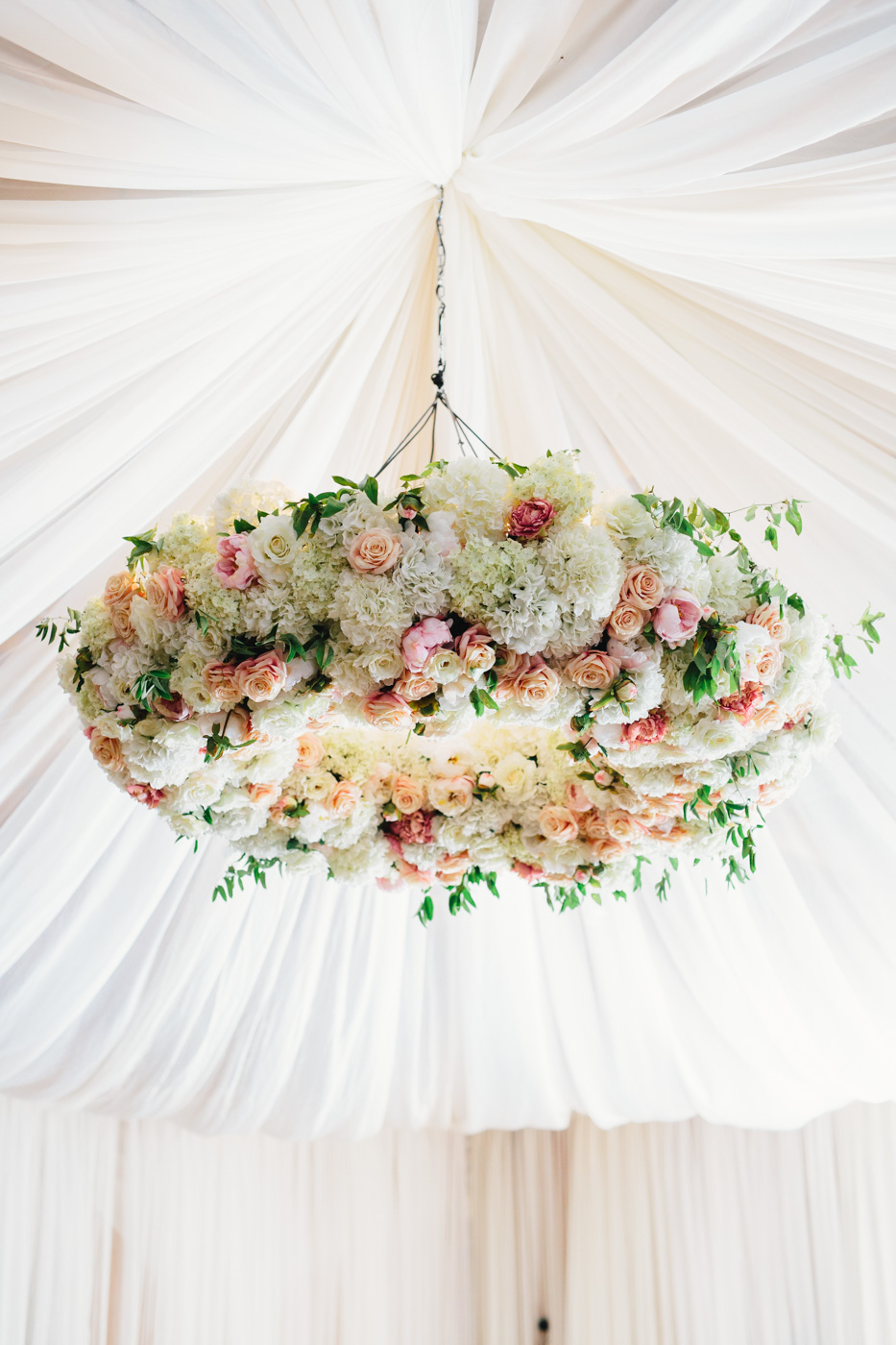 Flower chandelier at tented wedding reception over dance floor ideas
