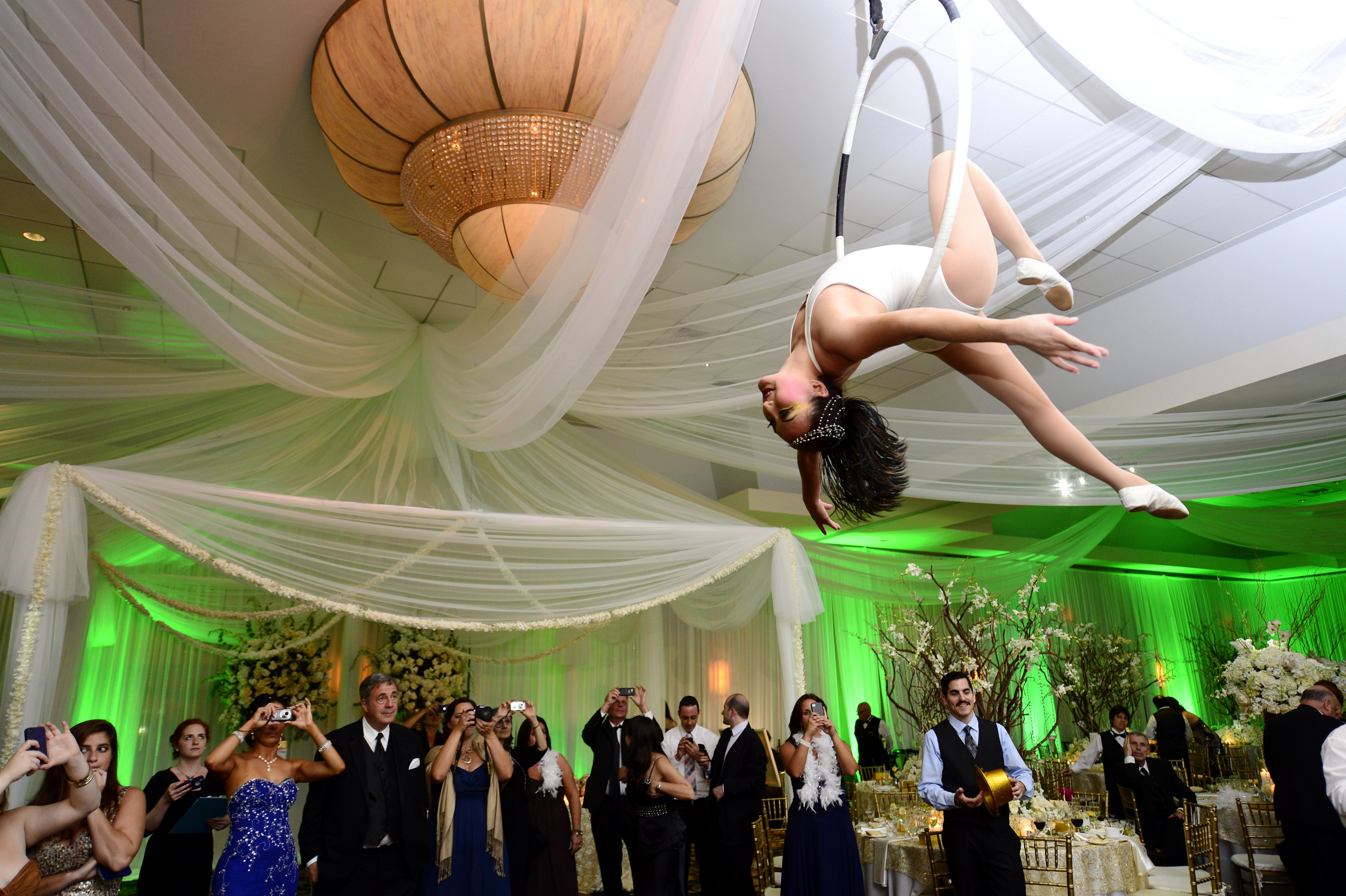 Wedding reception with unique performers aerialists acrobatic performance over dance floor