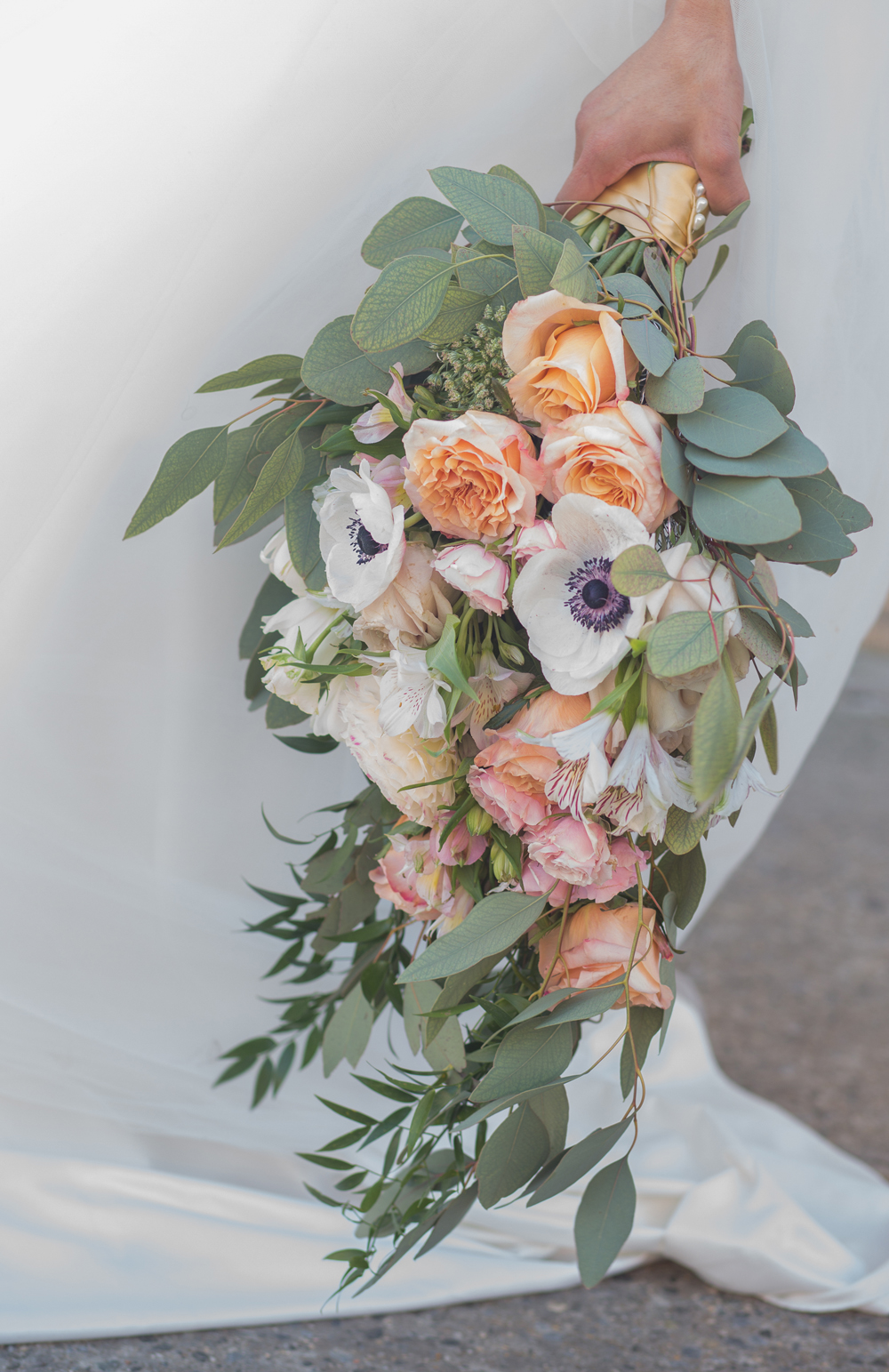 Bridal bouquet with anemone and garden roses accented with lots of greenery