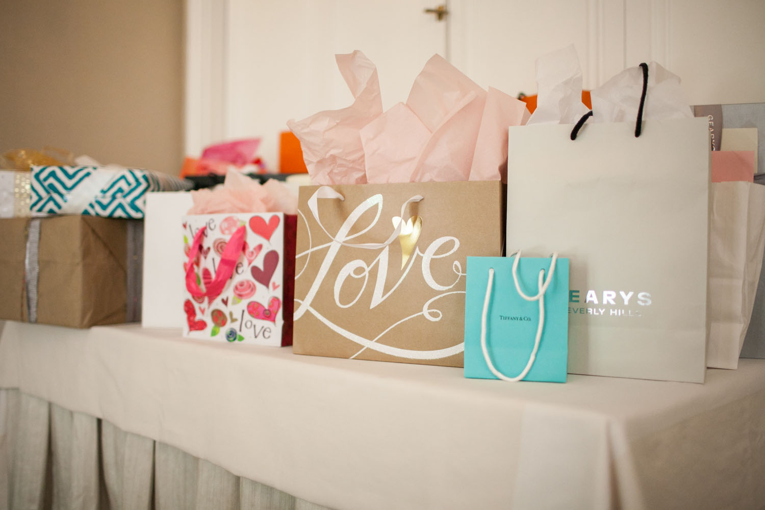 Bridal shower wedding registry gifts on table gearys tiffany love bags