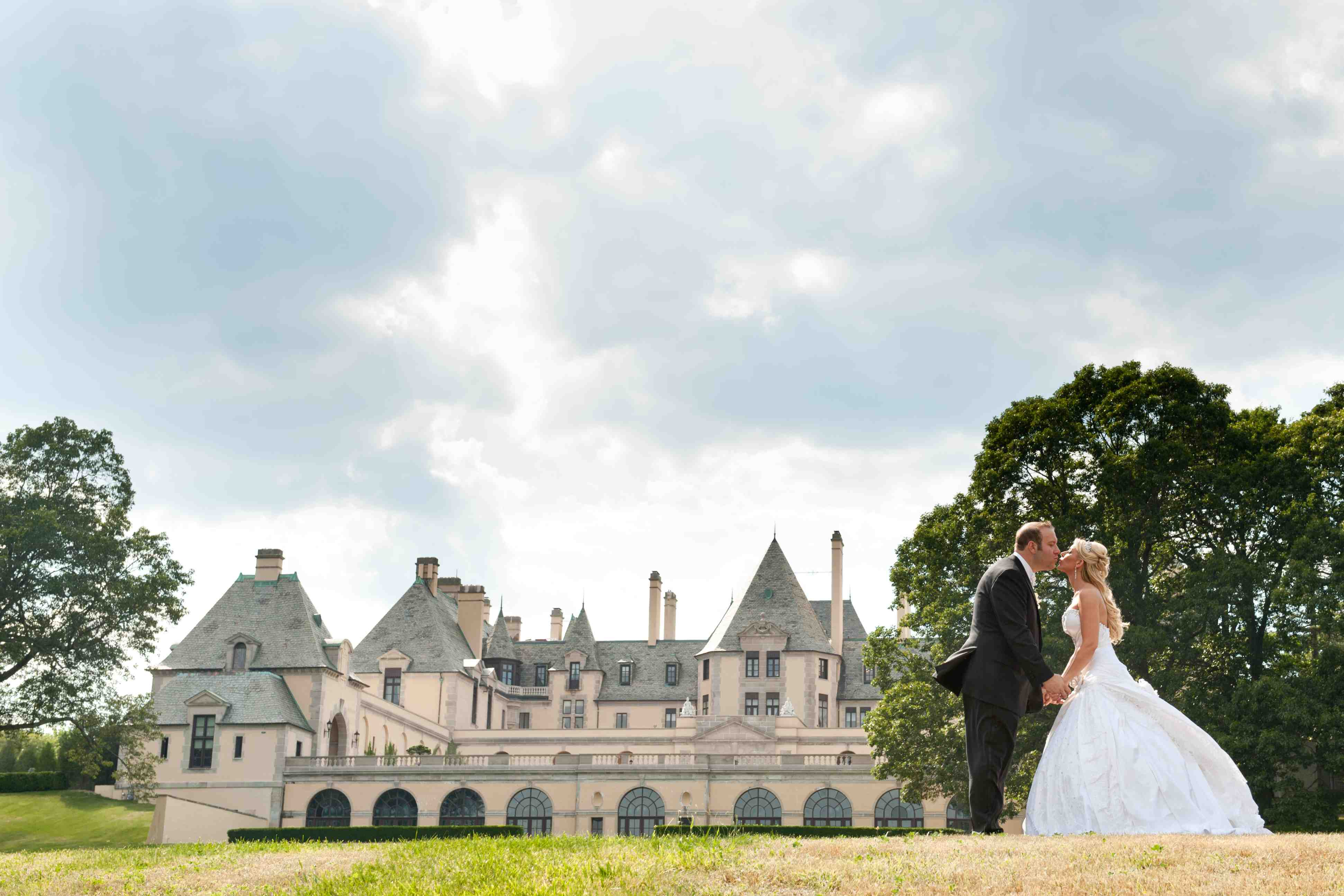 Bride and groom kiss wedding portrait oheka castle at castle wedding venue