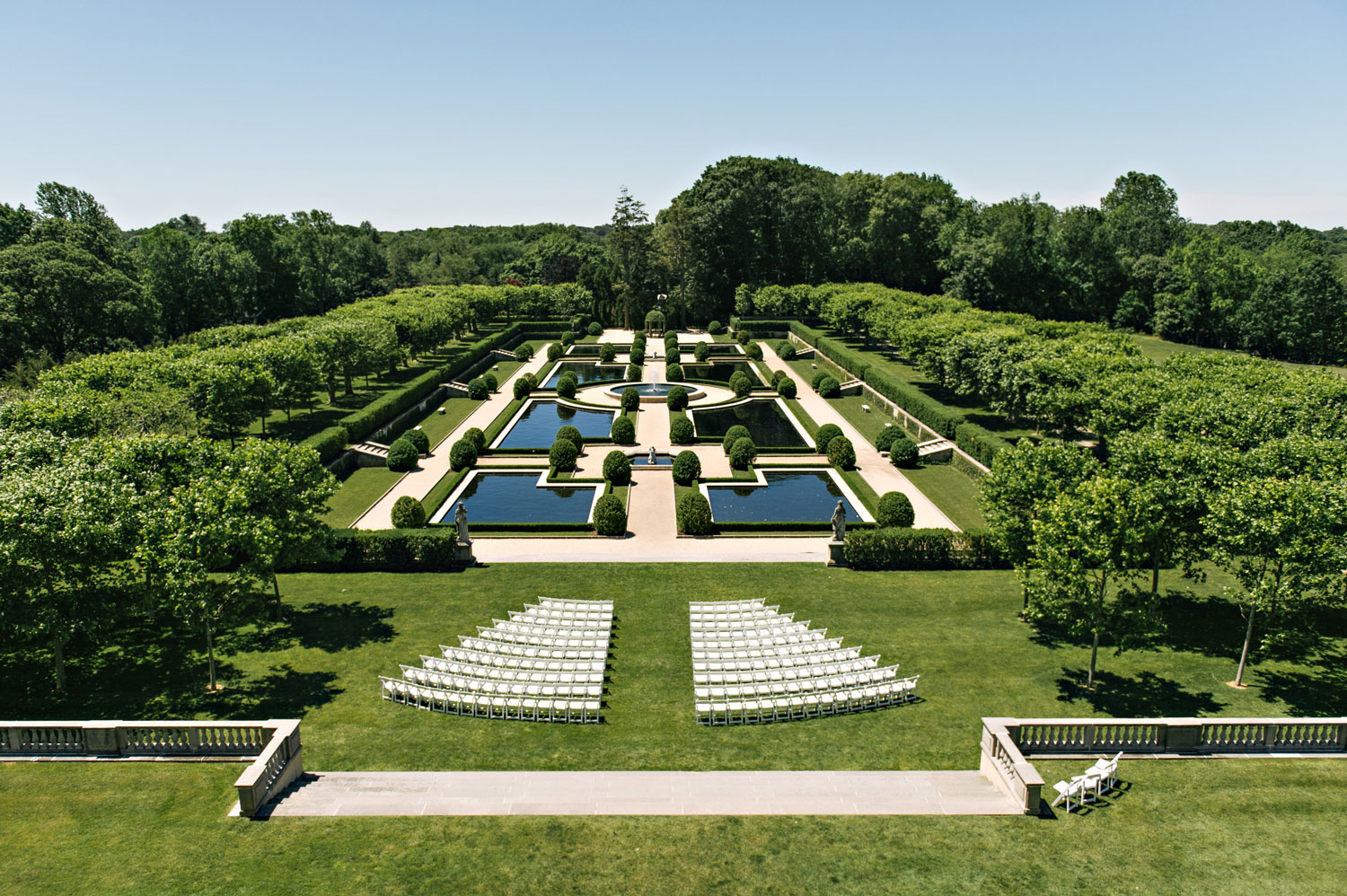 Ceremony set up on grounds of oheka castle castle wedding venue ideas