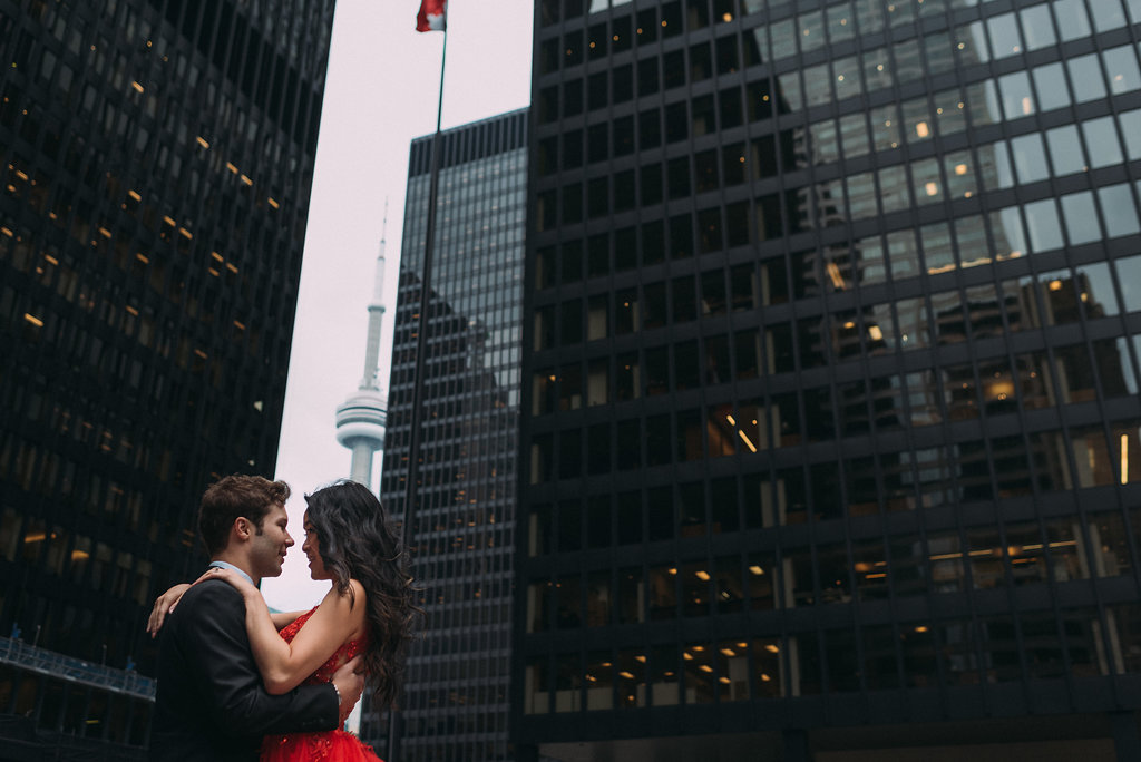 Bride and groom in front of buildings financial district in toronto engagement photo shoot ideas